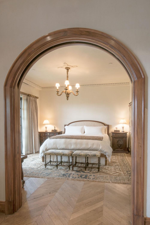 04-traditional-master-bedroom-curved-doorway-moulding-herringbone-floor-gary-drake-general-contractor.jpg