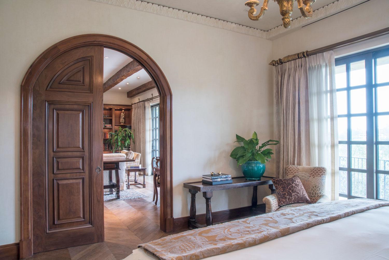 06-Curved-doors-bedroom-herringbone-floors-french-doors-gary-drake-general-contractor.jpg
