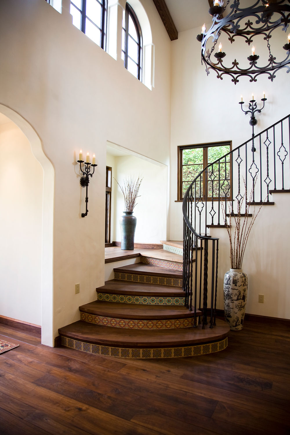 09-Spanish-style-staircase-tile-risers-iron-railing-gary-drake-general-contractor.jpg