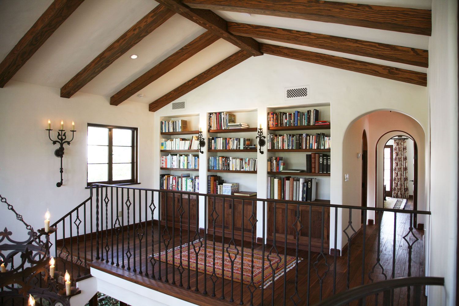 10-spanish-style-staircase-landing-beamed-ceiling-built-in-bookcases-gary-drake-general-contractor.jpg