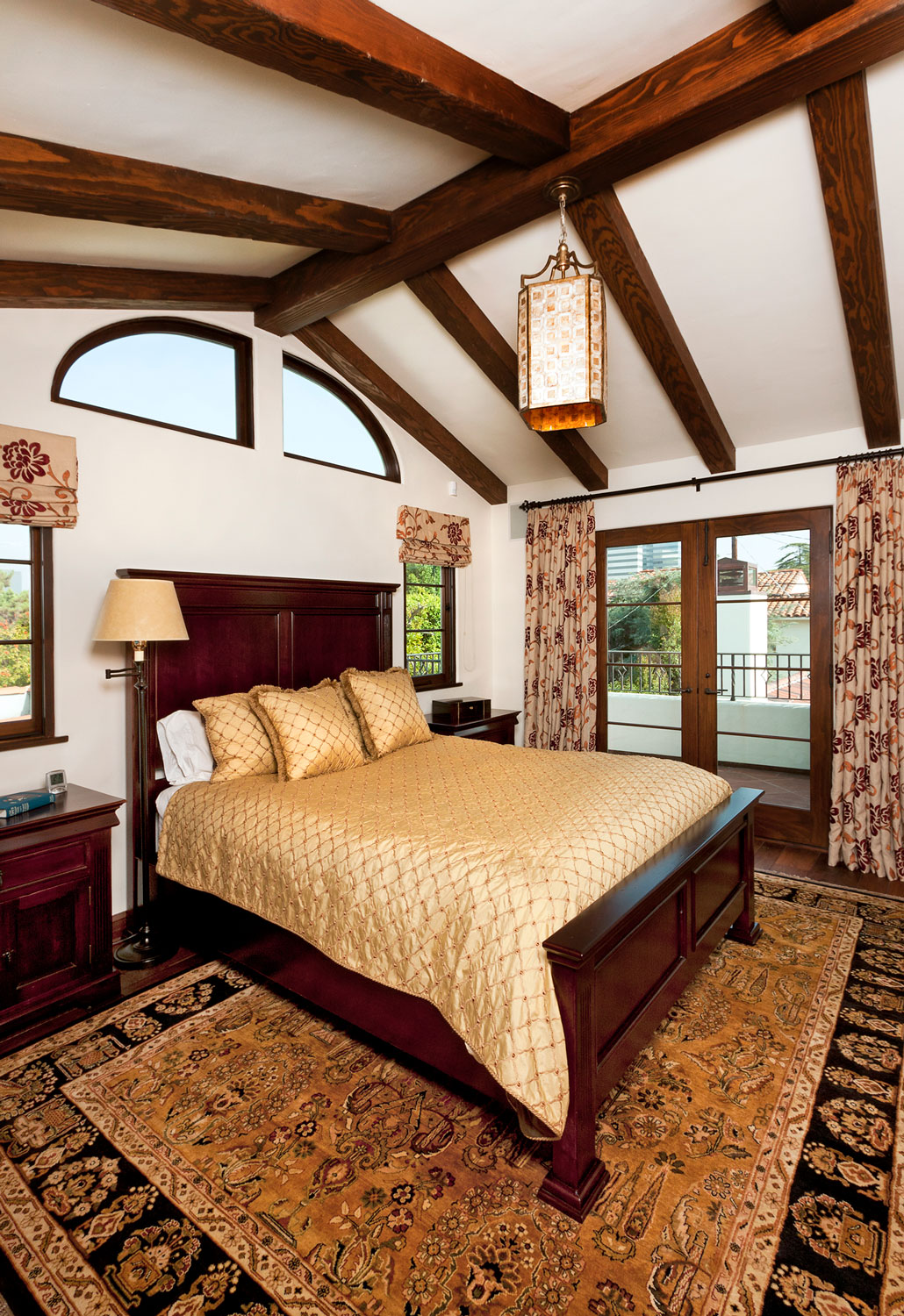 11-spanish-style-master-bedroom-beamed-ceiling-gary-drake-general-contractor.jpg