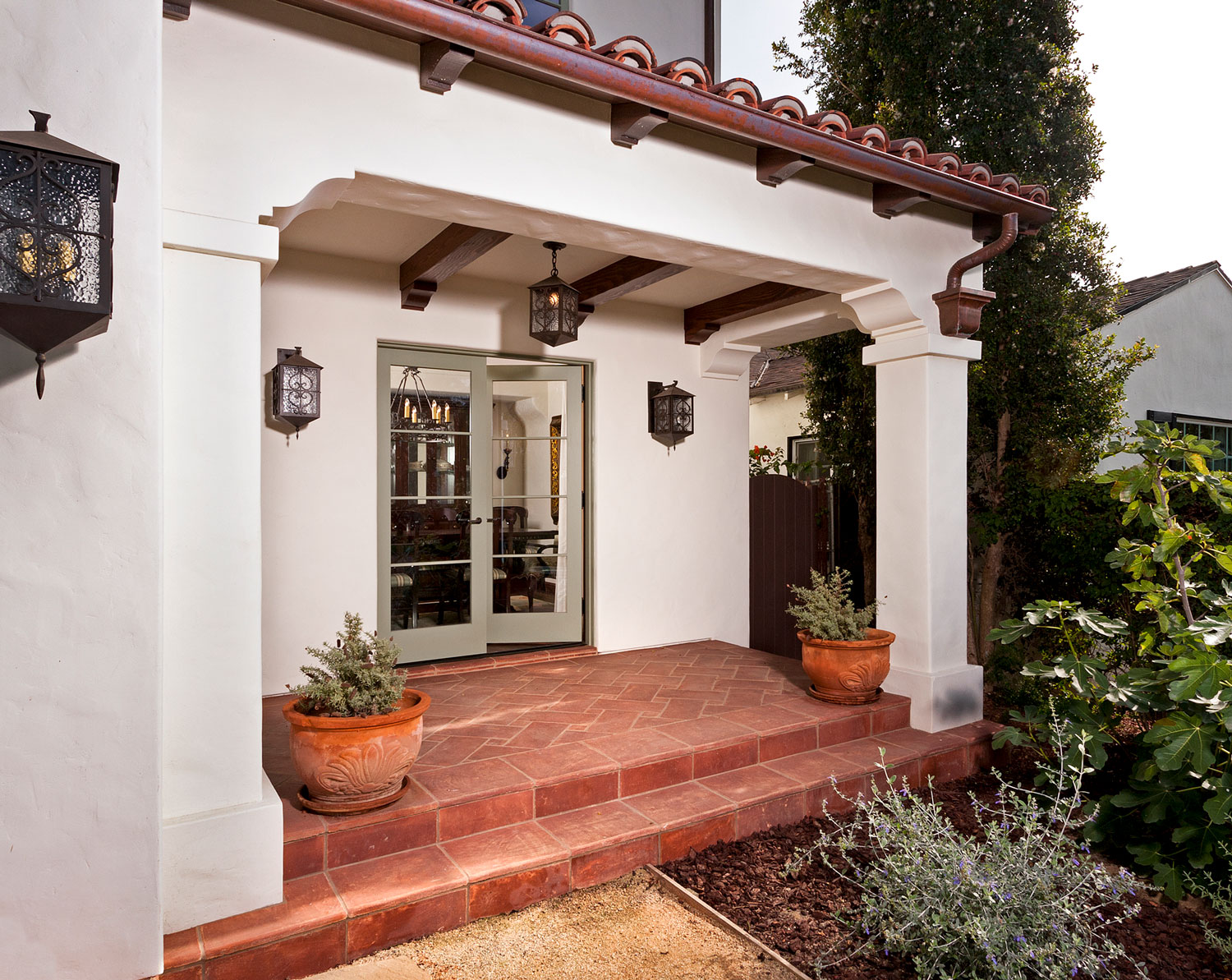 17-contemporary-spanish-tile-patio-french-doors-gary-drake-general-contractor.jpg