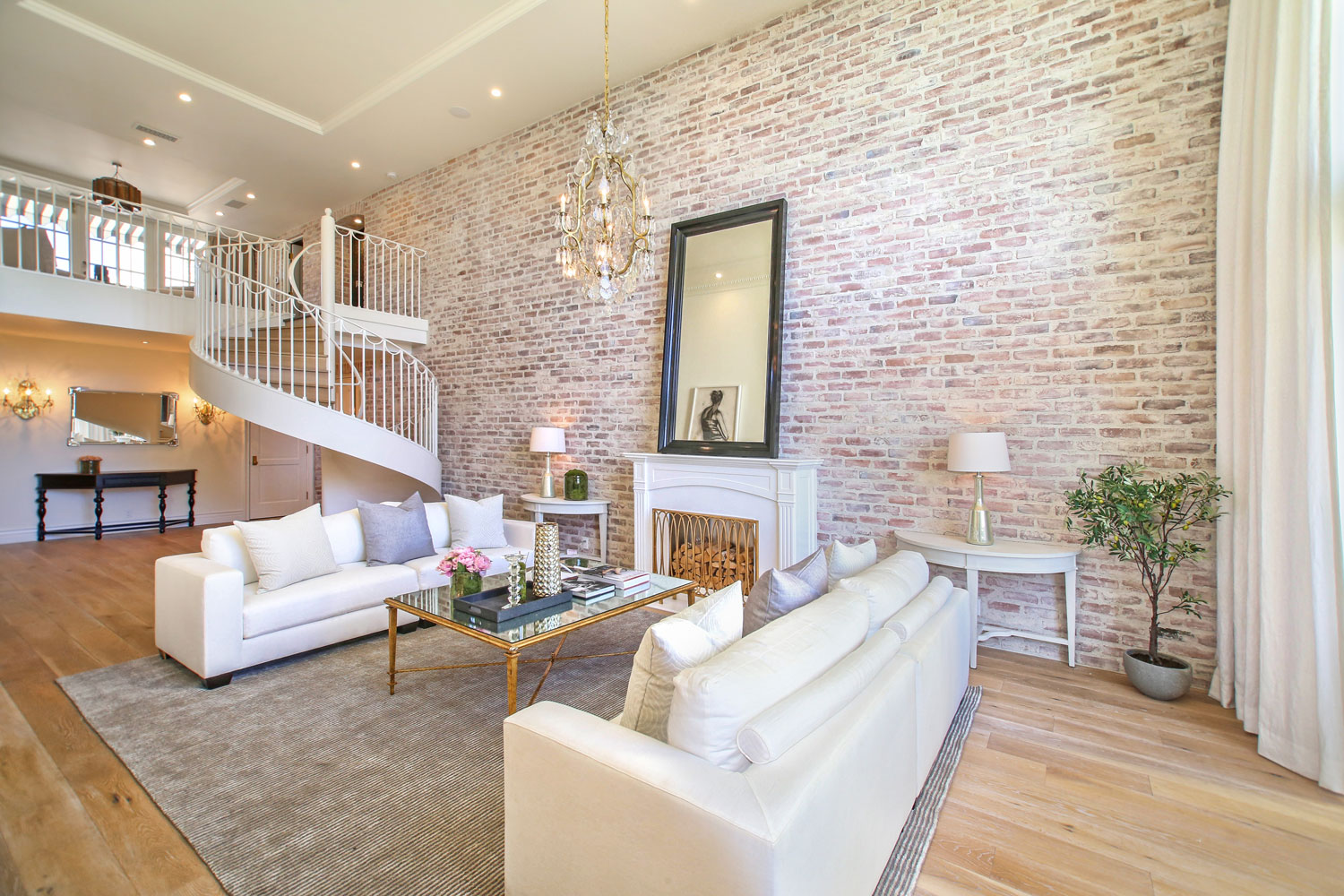 01-exposed-brick-walls-spiral-staircase-wide-plank-floors-gary-drake-general-contractor.jpg
