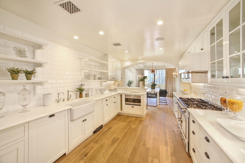 03-white-retro-kitchen-subway-tile-white-countertops-exposed-shelves-gary-drake-general-contractor.jpg