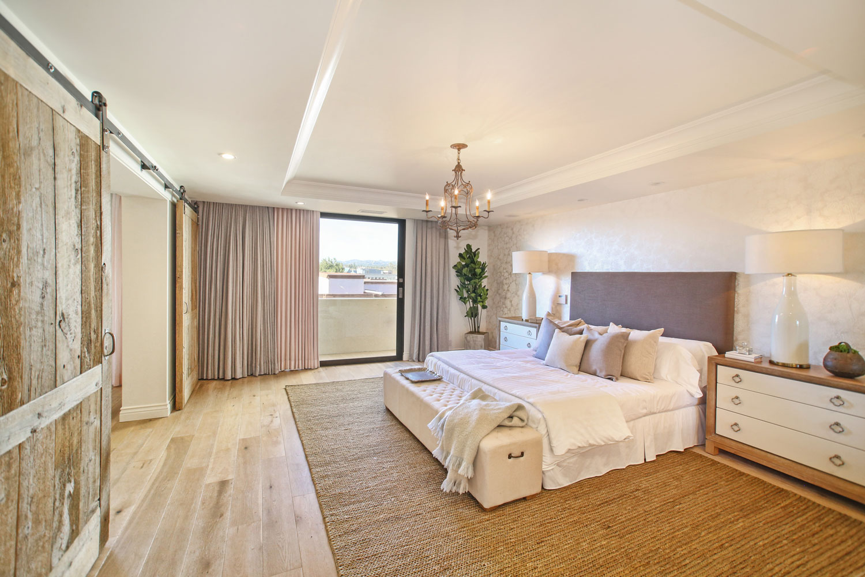 09-transitional-master-bedroom-barn-doors-gary-drake-general-contractor.jpg