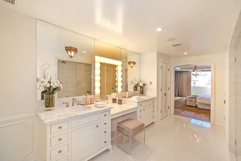 11-master-bathroom-penny-tile-floor-paneling-makeup-vanity-gary-drake-general-contractor.jpg