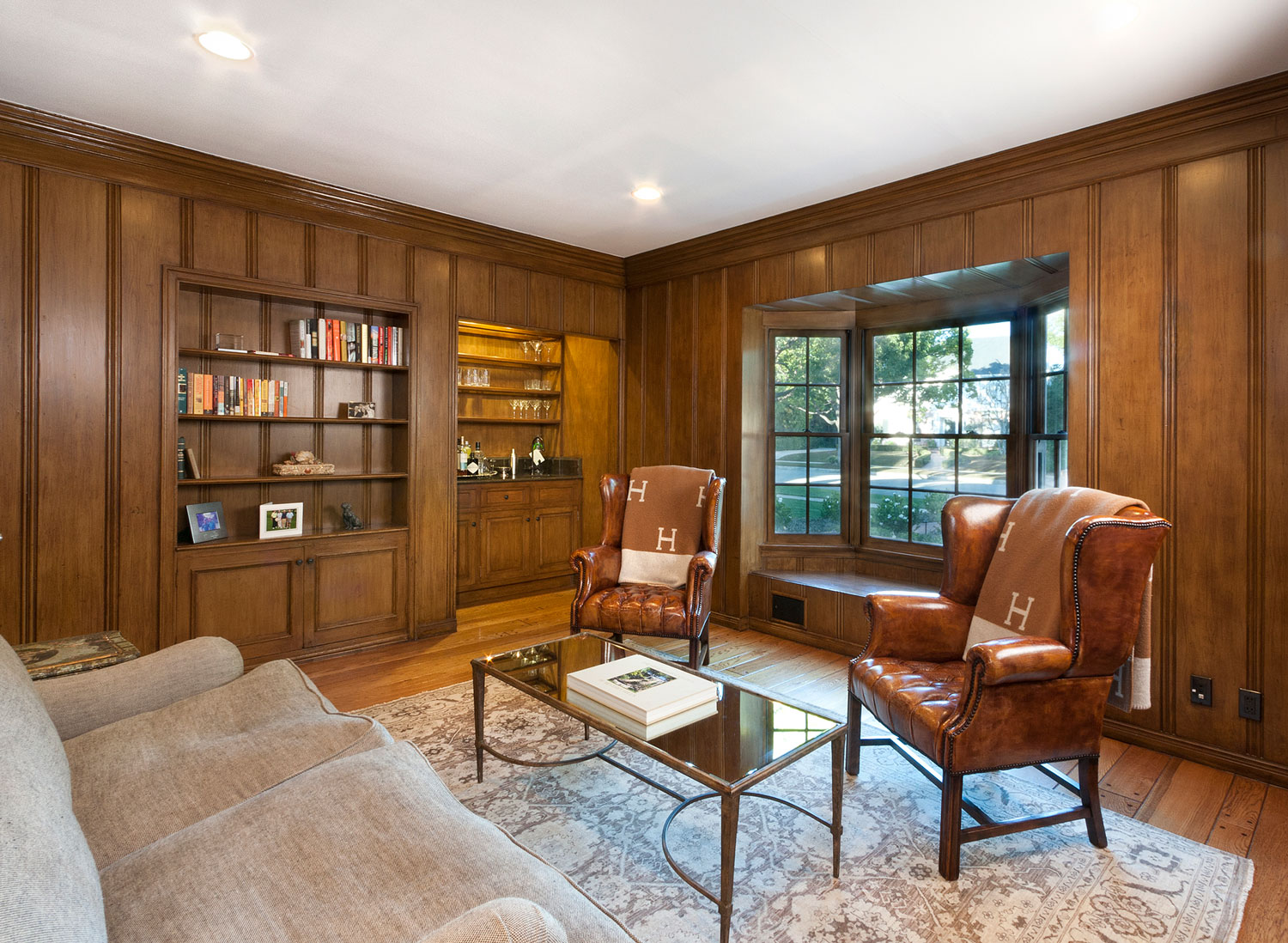 07-wood-paneled-home-office-built-in-shelves-window-seat-gary-drake-general-contractor.jpg