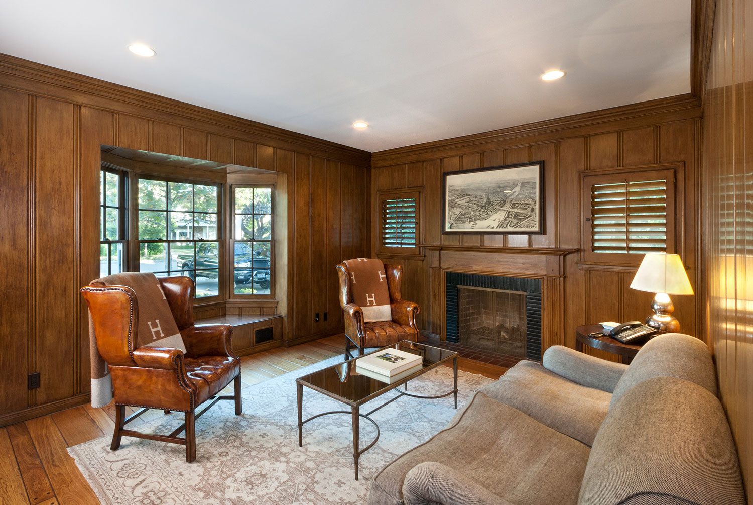 08-wood-paneled-office-fireplace-window-seat-gary-drake-general-contractor.jpg