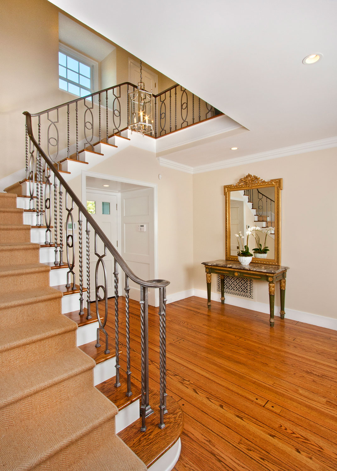 09-front-entry-staircase-iron-railing-gary-drake-general-contractor.jpg