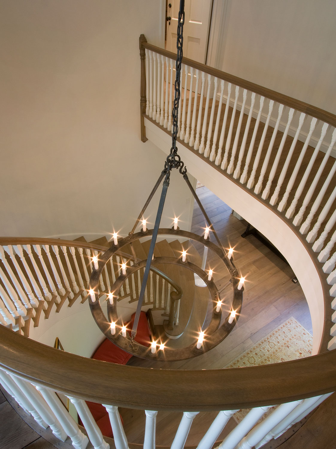 09-A-traditional-staircase-wood-railing-curved-gary-drake-general-contractor.jpg