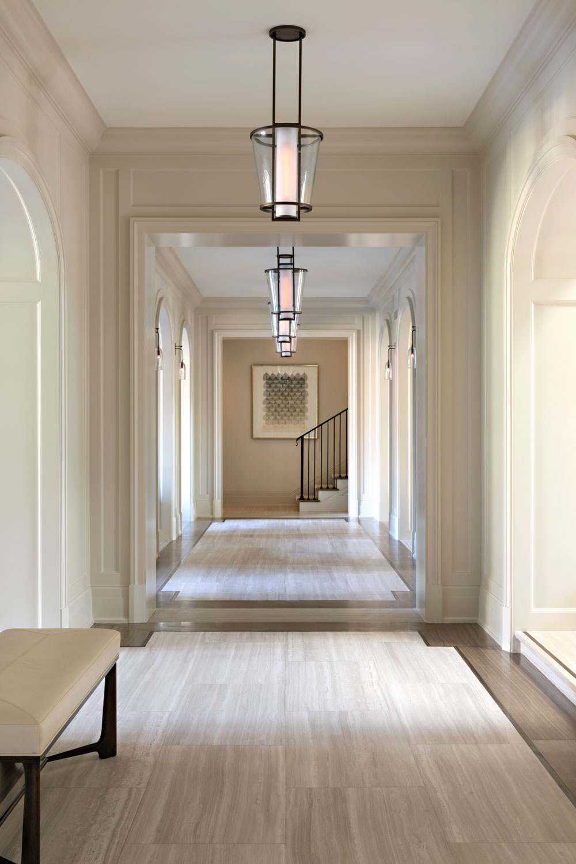 07-transitional-hallway-sleek-paneled-walls-inlay-floor-gary-drake-general-contractor.jpg