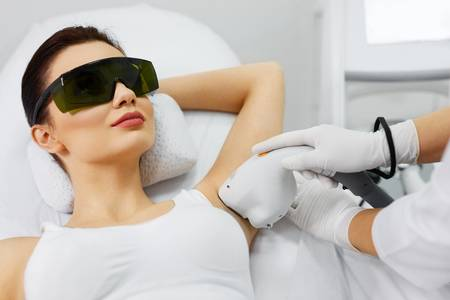 74892868-laser-hair-removal-closeup-of-beautician-removing-hair-of-young-woman-s-armpit-beauty-epilation-trea.jpg