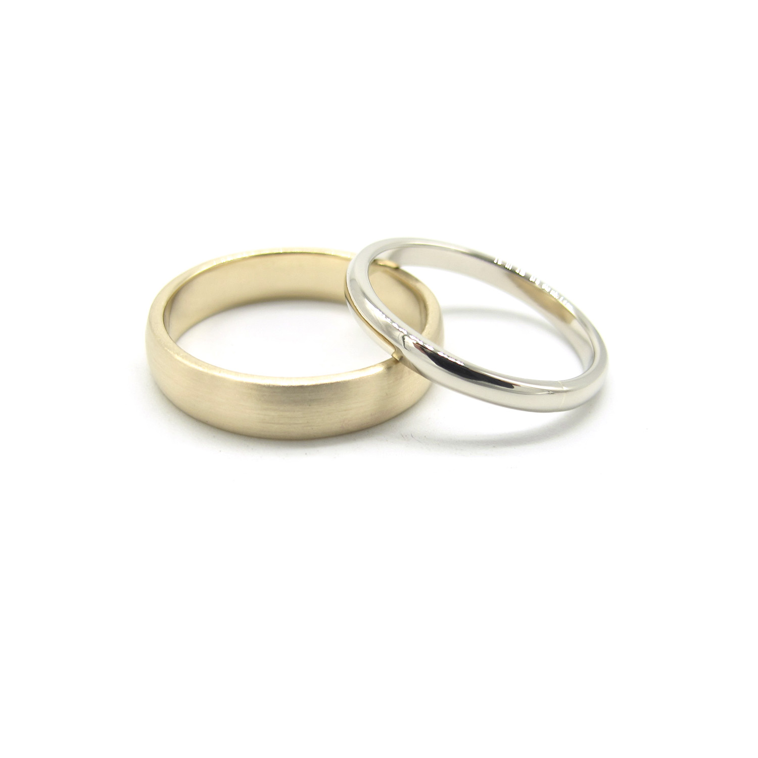 Wedding bands in 14k gold and 18k white gold.