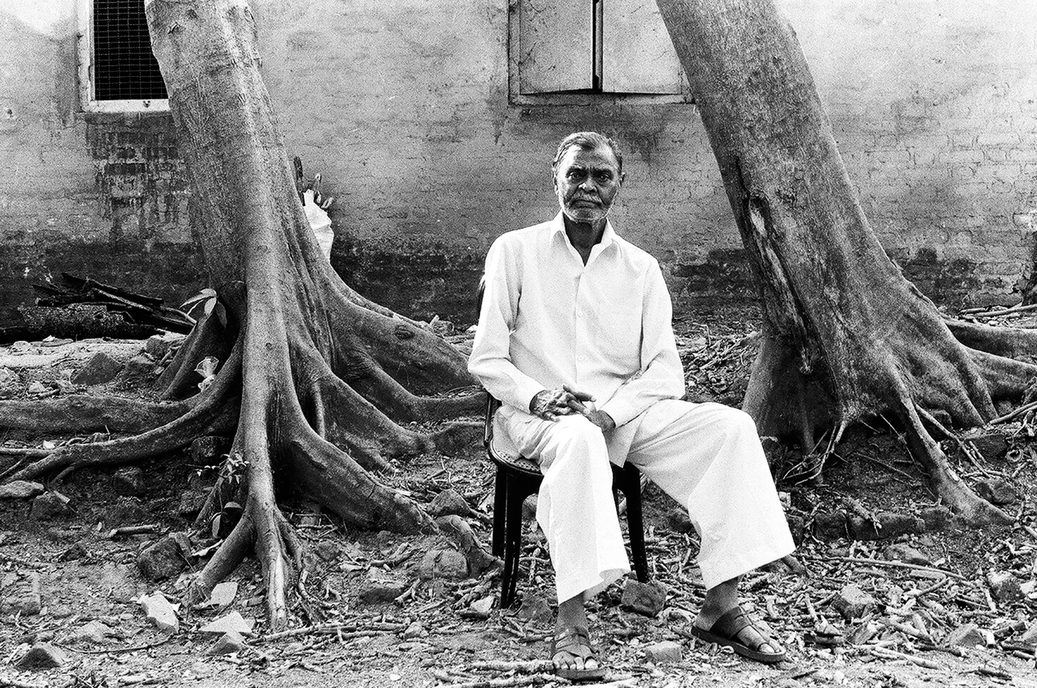 1. Potrait of Tukaramji in front of his house as he takes out some time to rest between his work | 02900014.jpg