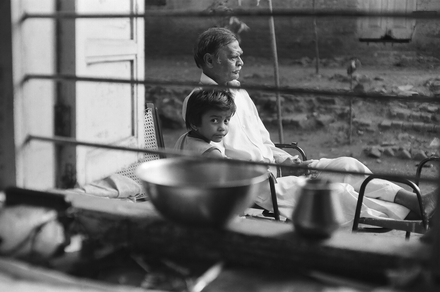 7. Tukaramji with his granddaughter who is looking into the camera. She is used to acting in a lot of films that students have to make as part of their projects | 05400003.jpg