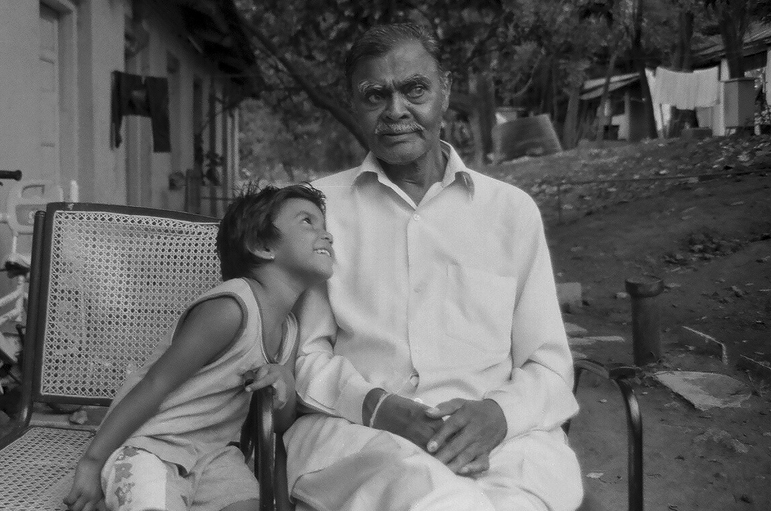 9. Tukaramji with his granddaughter who is looking into the camera. She is used to acting in a lot of films that students have to make as part of their projects | 05400021.jpg