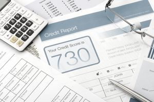 credit-report-form-on-a-desk-with-other-paperwork--643148934-59ac8218b501e800114e8f7b.jpg