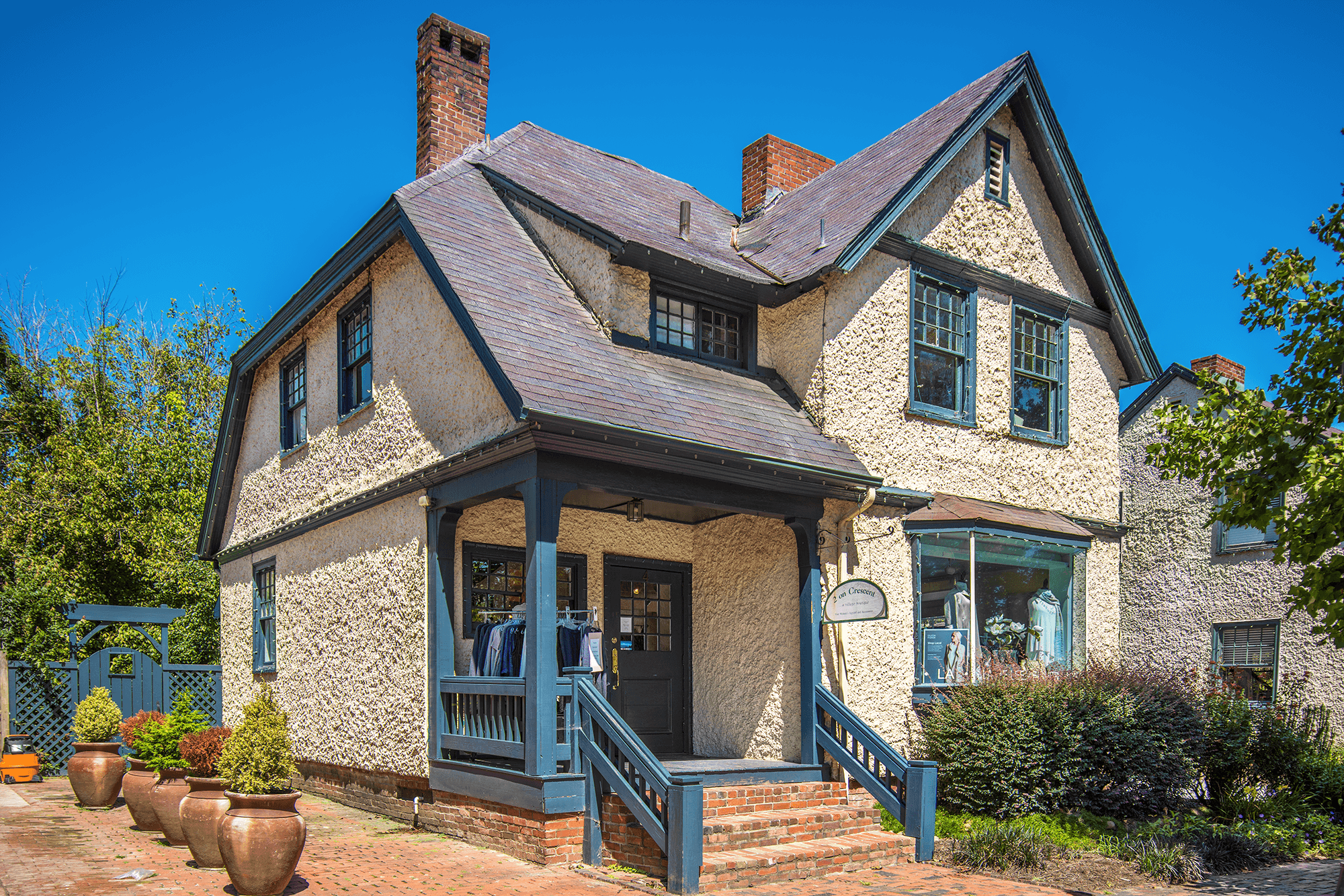 This cottage on 4 All Souls Crescent is small and has only a one-bay recessed porch with a two-story gable-end projection. Today, the cottage is a women's clothing store  2 On Crescent .