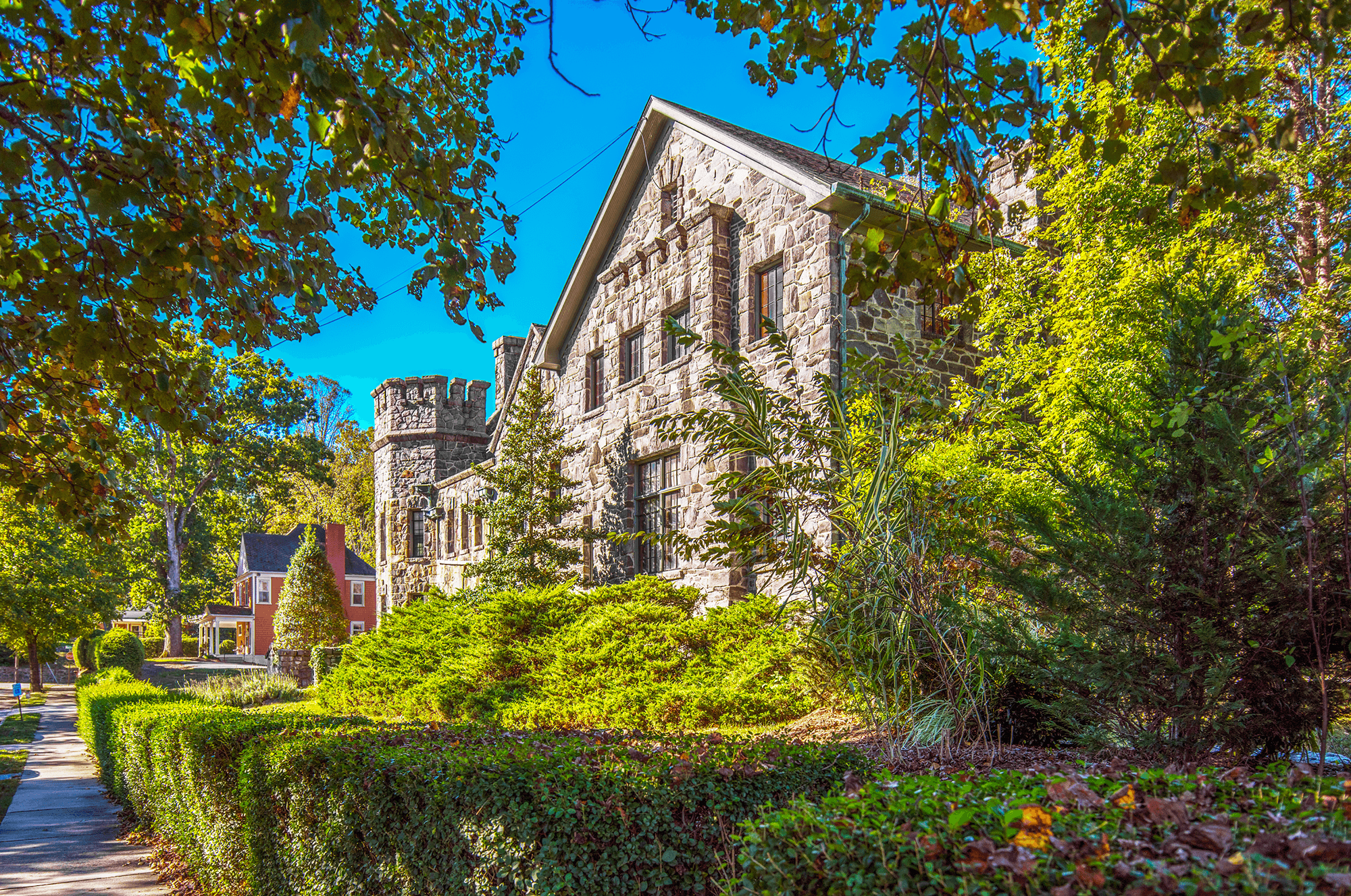 Homewood  is one of the unique buildings in the historic Montfort District, resembling more a castle or an English stone manor than a typical 1920s mansion.