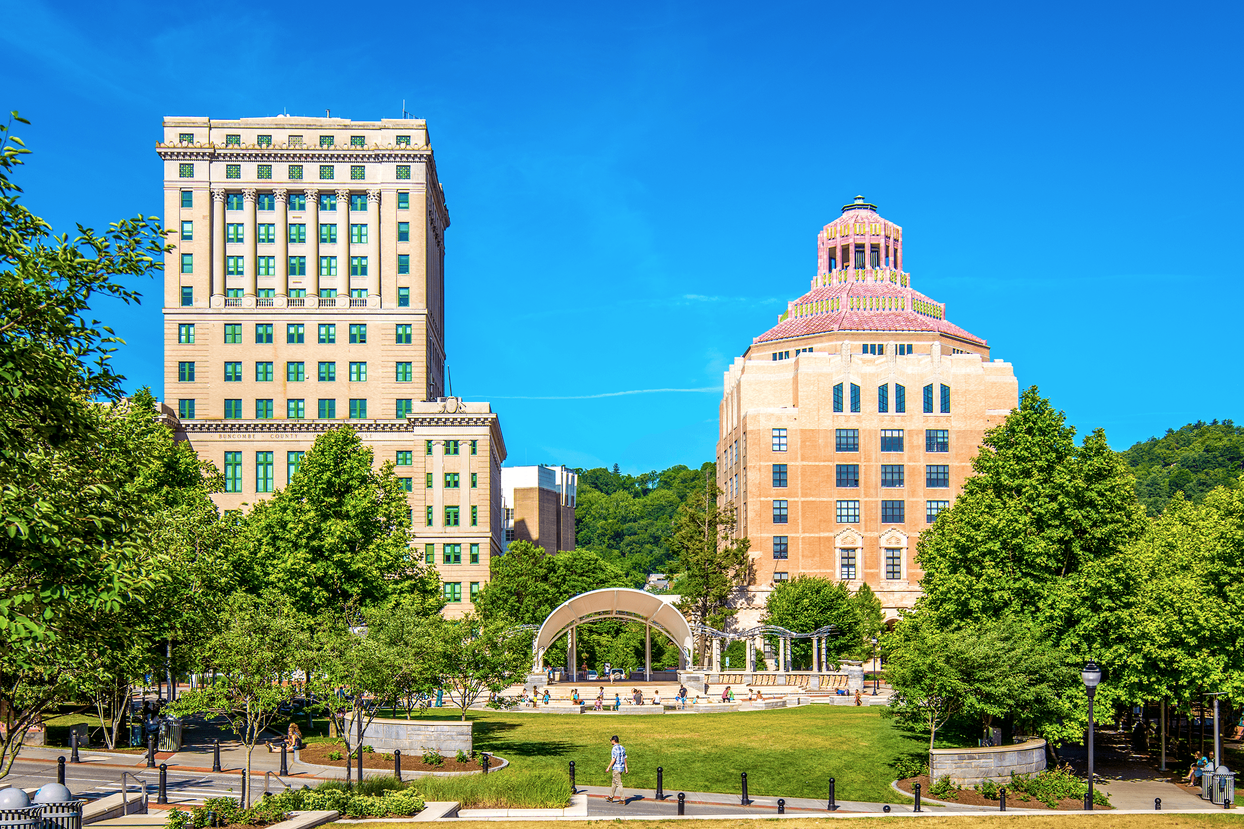 """Originally, Douglas Ellington had proposed that the Buncombe County Courthouse and the Asheville City Hall matched. The County Commissioners, however, found the Art Deco style """"ostentatious and preferred a more traditional approach."""" The result was a neo-classical building contrasting Ellington's Art Deco style City Hall."""