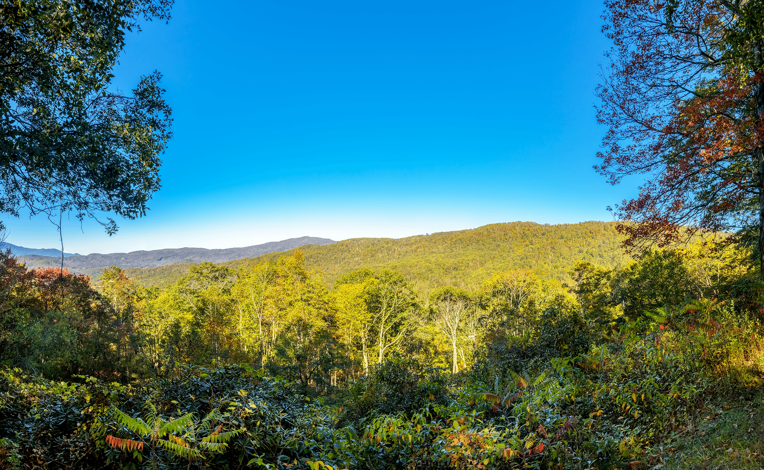 The west-facing  North Toe River Valley Overlook  at Milepost 318.4 is a favorite spot for mountain sunset views. Less known, however, is that this section of the Blue Ridge Parkway is the only section that follows closely an earlier scenic highway, the  Crest of the Blue Ridge Highway , which was built in 1912, but whose construction was abandoned by 1917 when the U.S. entered WWI.
