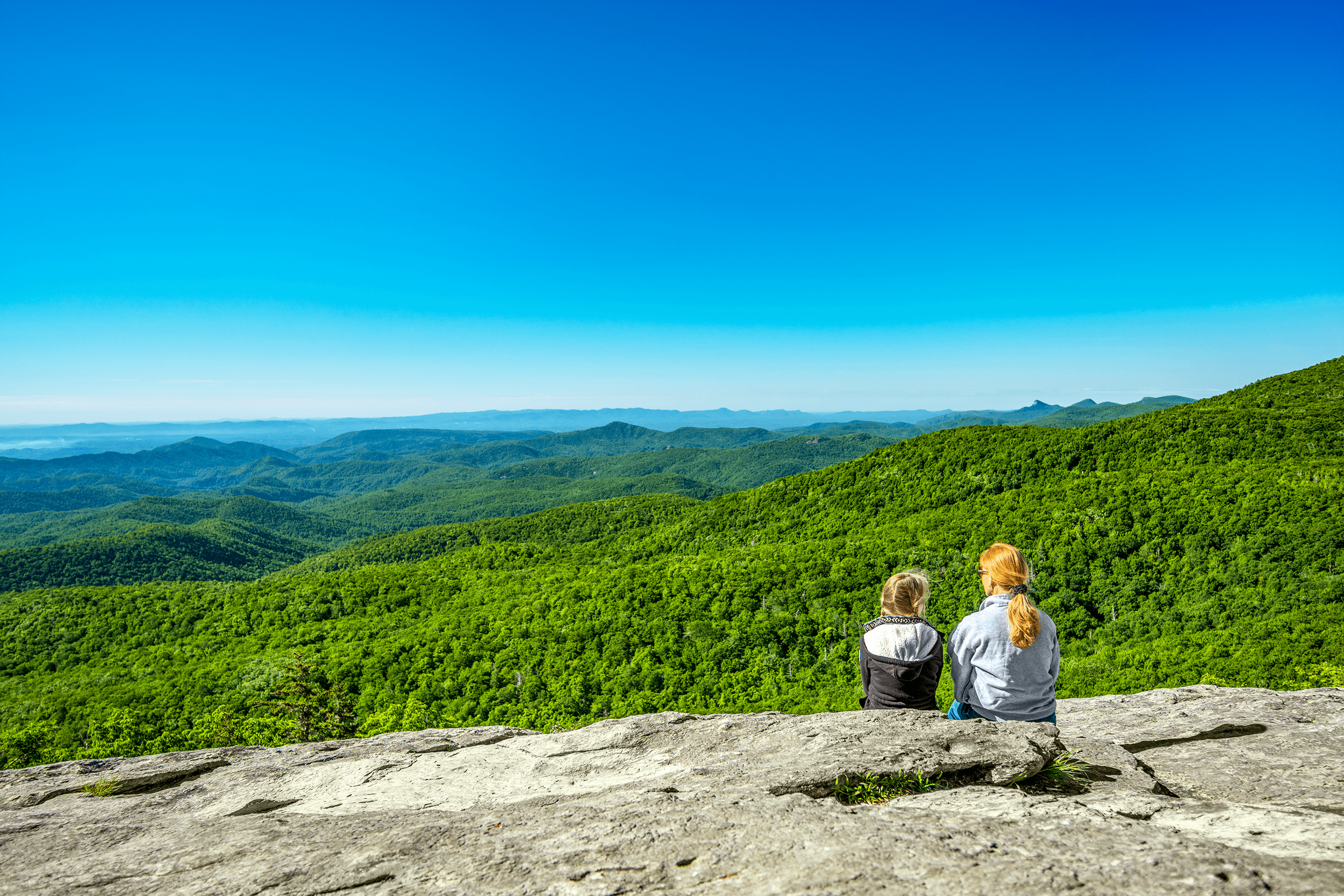 After a short easy to moderate hike, the  Beacon Heights Trail  opens up to the south-facing rock formation. The surface of the rock is smooth and offers a perfect place for a nice picnic with incredible long-range views as a backdrop.