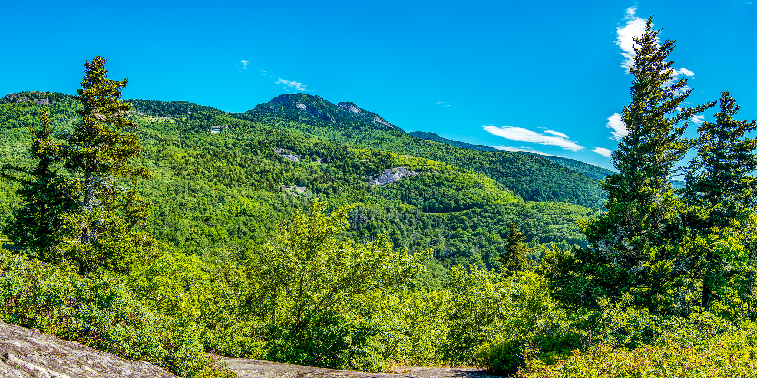 The north-east facing rock-dome offers spectacular views of  Grandfather Mountain , towering high above the  Beacon Heights Overlook . If you love long-range views and a fantastic place for a picnic, the  Beacon Heights Overlook  should be on your list.