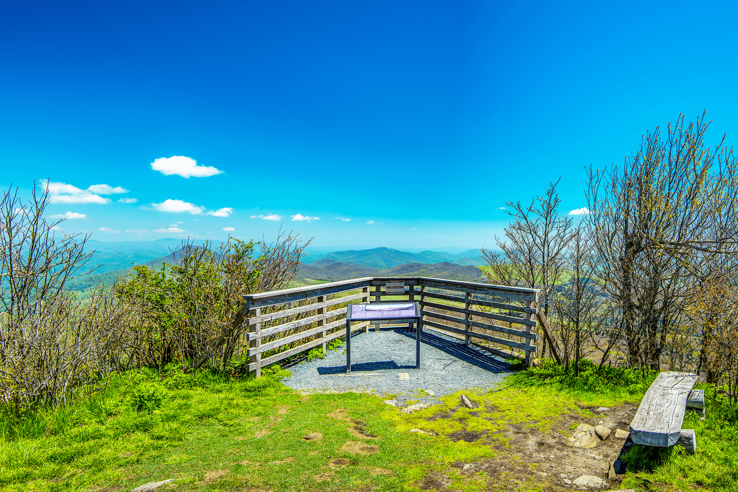 The north lookout is the summit of  Elk Knob  at an elevation 5,520 feet (1,682 meters). The platform features two benches on either side. Similar to the south lookout, an information sign explains the mountain range in view.