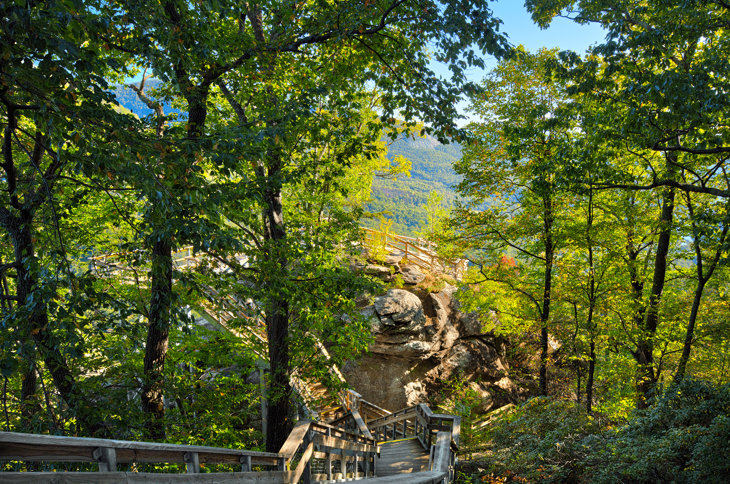 Continuing your hike up on the  Ultimate Stairmaster , you can take a brief stop on one of the many landings as an opportunity to not only catch your breath but also to turn around and enjoy the stunning scenery. Here a view of  Pulpit Rock  below.