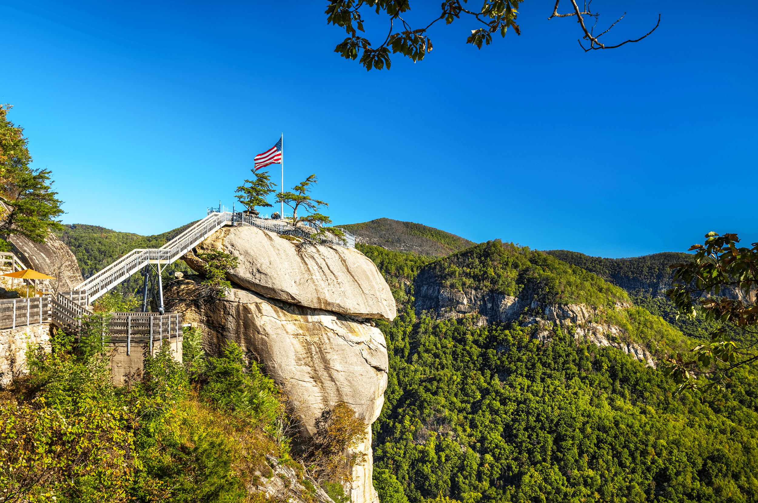 While taking a rest on the terrace of the  Sky Lounge , you can enjoy picture-perfect afternoon views of  Chimney Rock . For those, who took the elevator up, this would be the first up-close glimpse of  Chimney Rock  as you exit the Sky Lounge.