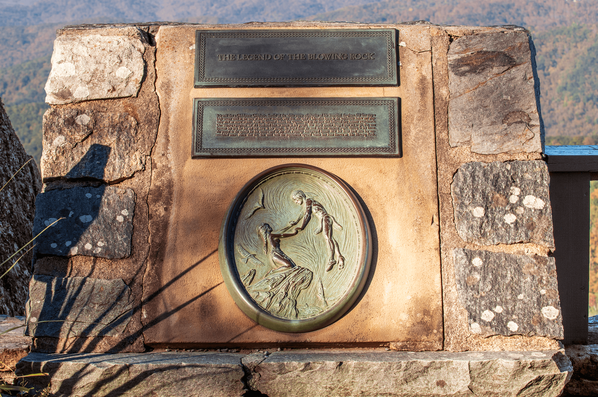A small stone memorial with a brass plaque, describing the legend, is located on the side of  The Rock .