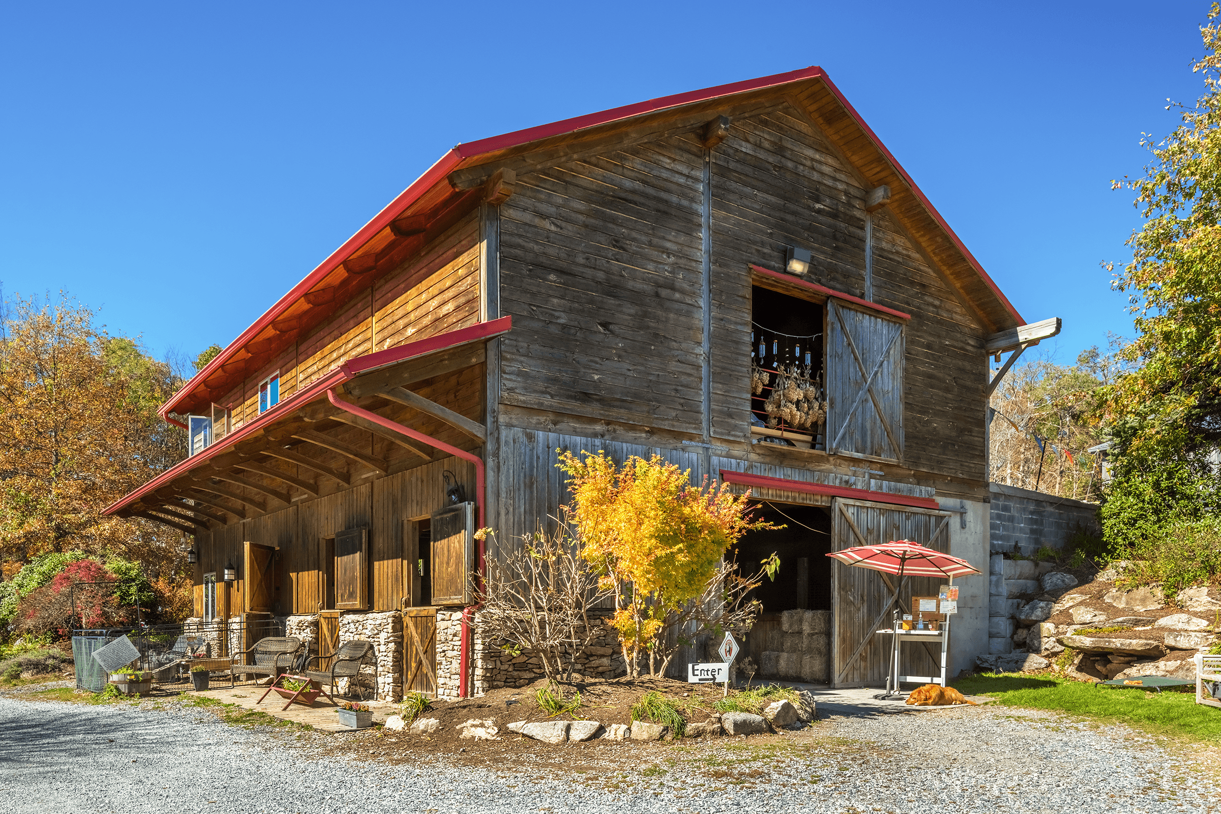 When you arrive, you can park your car in the designated parking spots across from the barn. The store on the second floor is accessible by stairs from the inside or by walking around the building to the back.