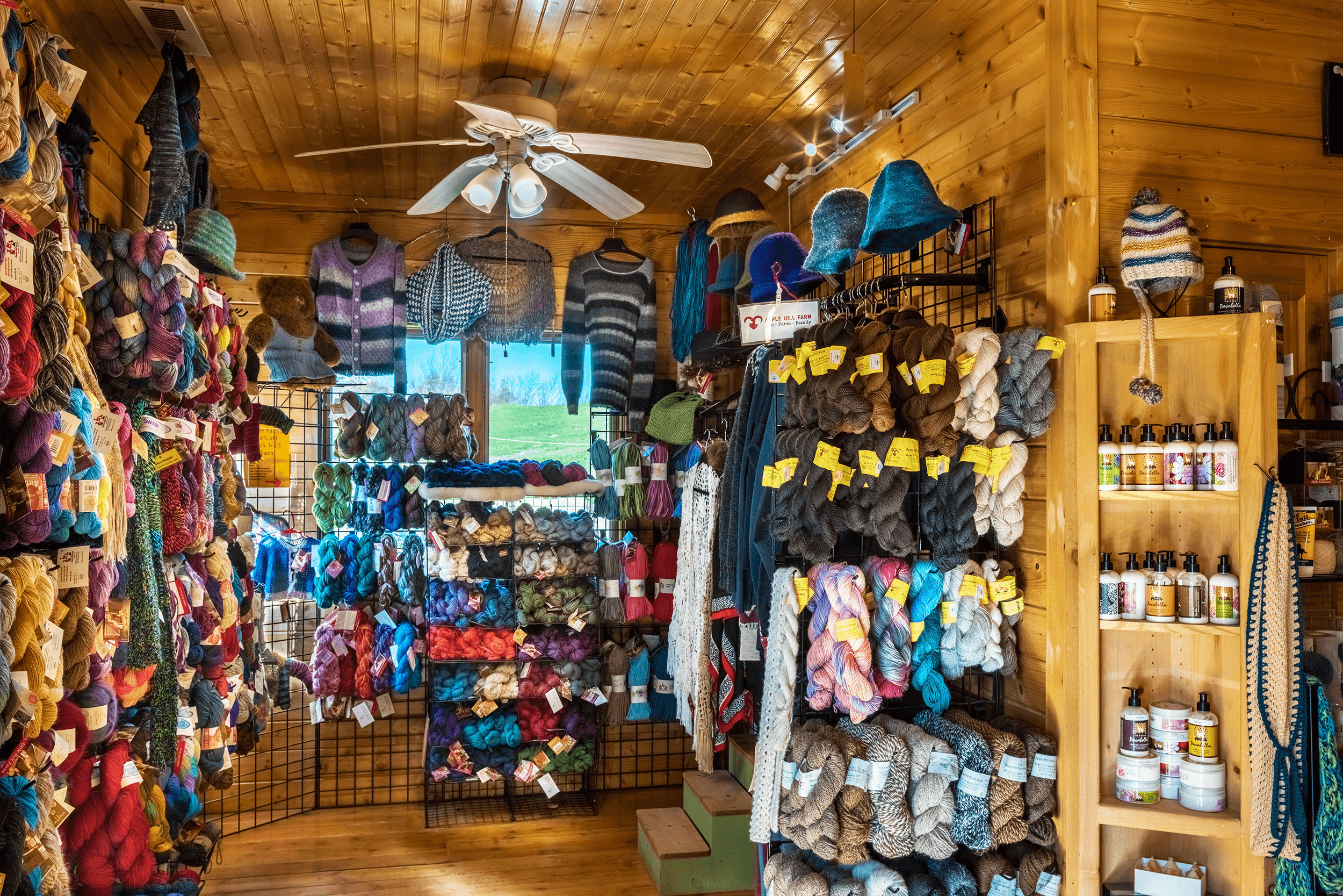 The onsite store offers a wide selection of alpaca yarn. Items marked with a yellow label are made of yarn from the farm's herd.
