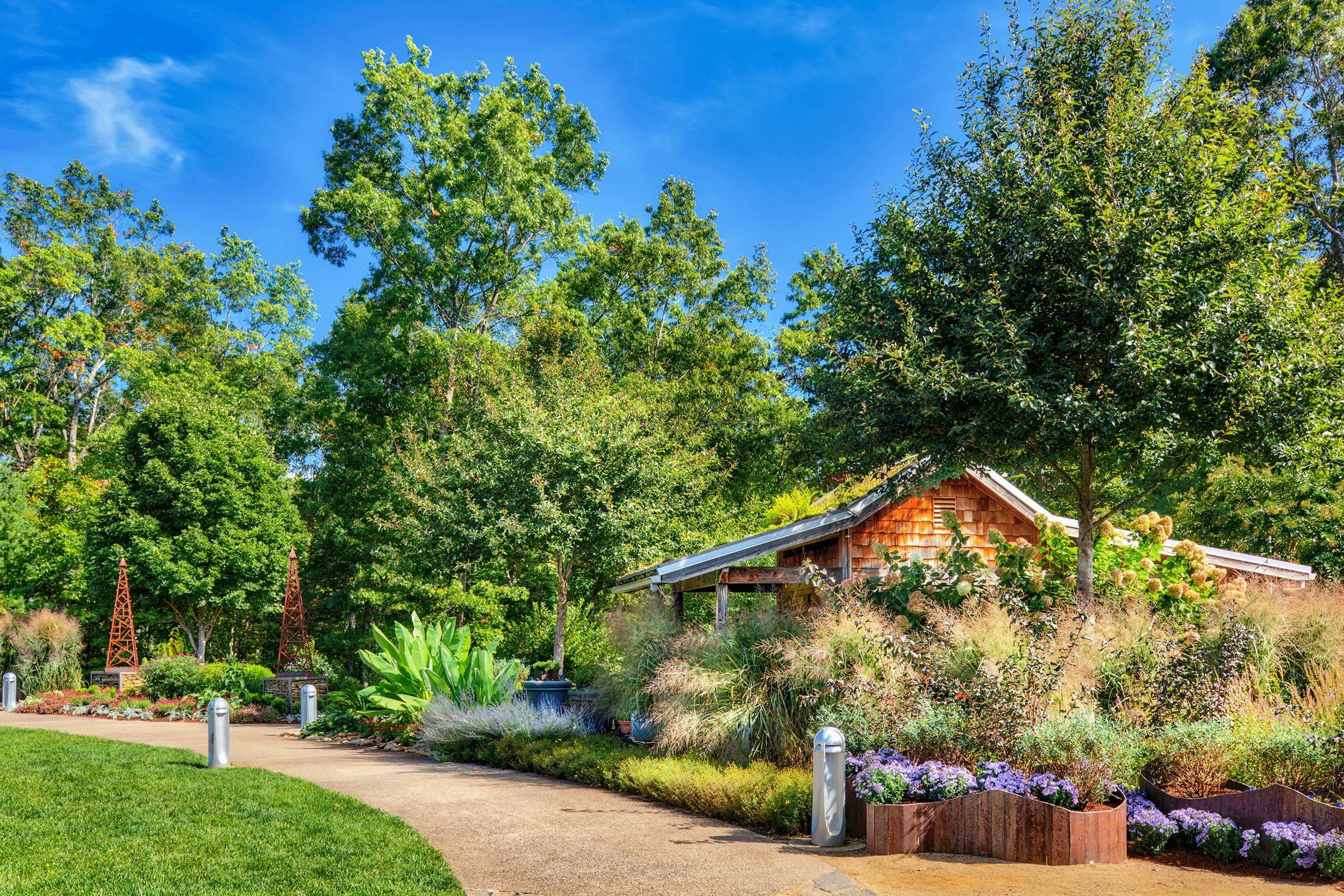 The  North Carolina Arboretum  is open year-round and offers picturesque vistas while you stroll through the neatly arranged gardens or relax on one of the many benches, enjoying the serenity of nature.