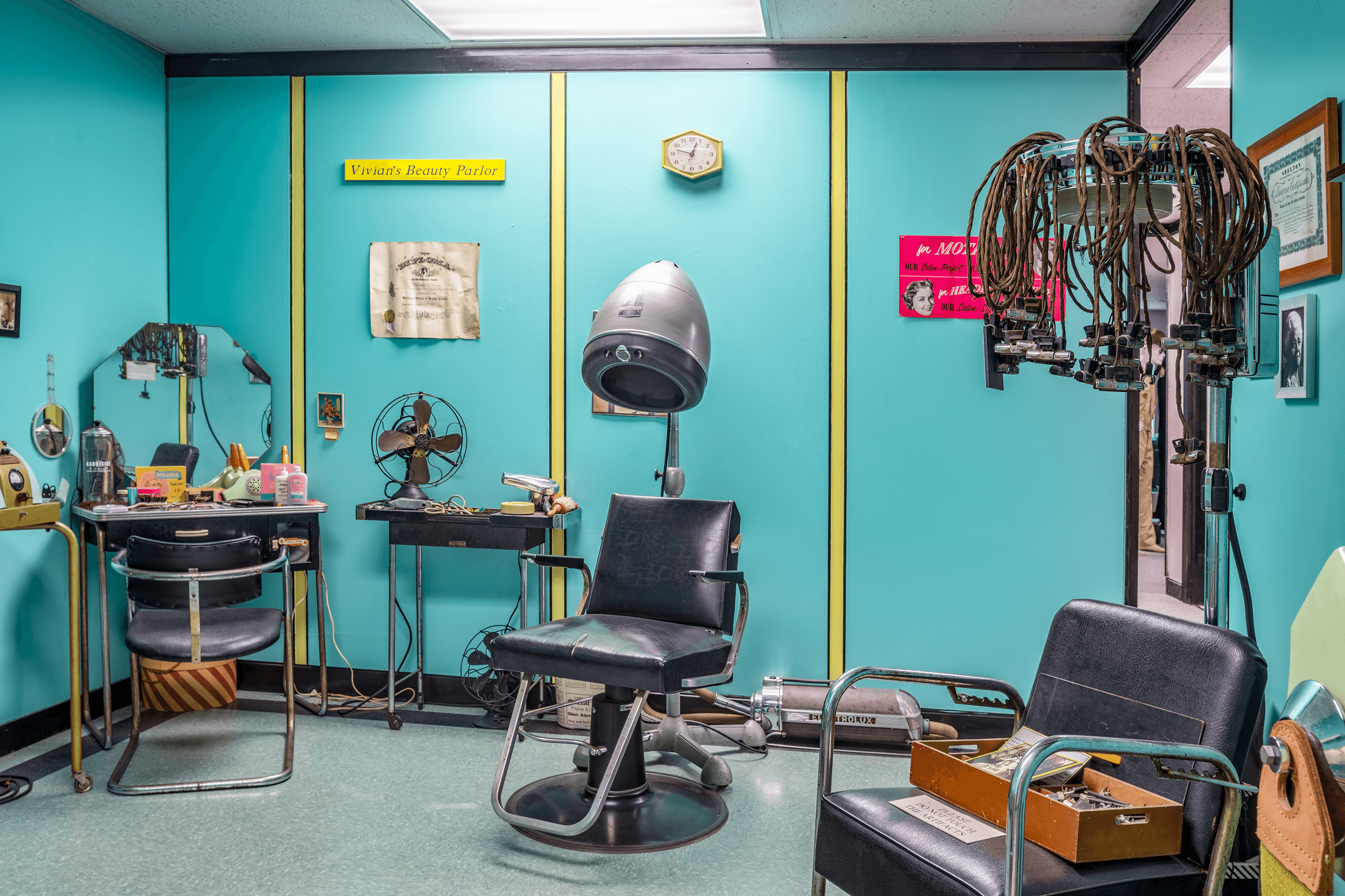 Another room features  Vivian's Beauty Parlor  from the 1950s with a vintage electric perm machine (pictured on the right).