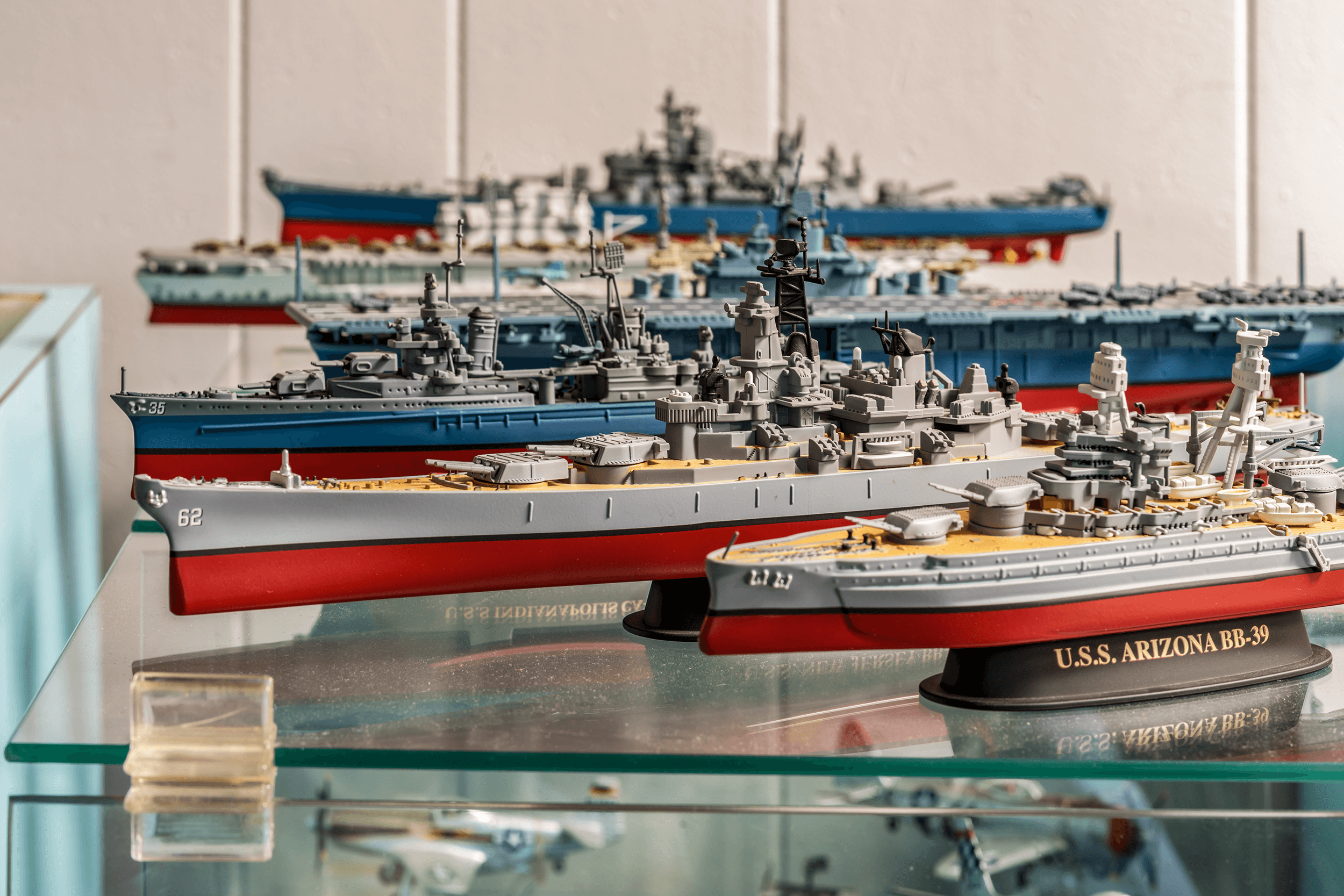 Pictured here is a model of the  U.S.S. Arizona BB-39 , which was commissioned in 1916 and sunk during the Japanese attack on Pearl Harbor in 1941. Behind it is the  U.S.S. New Jersey BB-62 , which earned 19 battle stars and is the most decorated battleship in the U.S. Navy's history. Decommissioned for the first time in 1957, she was reactivated for one year in 1968 to support U.S. troops in Vietnam. As part of the Navy modernization program, the  U.S.S. New Jersey  was modernized to carry missiles and put into service once more in 1982. She was decommissioned for the last time in 1991 and today serves as a museum ship in Camden NJ.