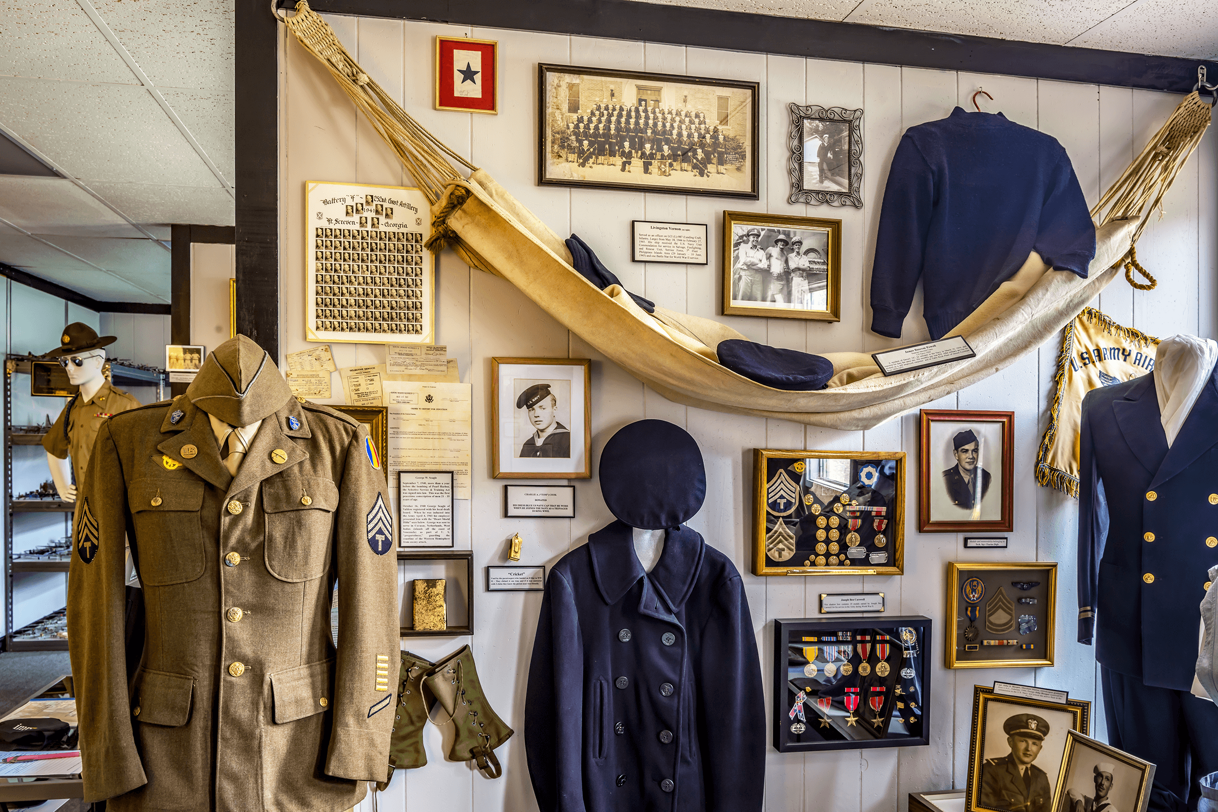 """The hammock on display belonged to resident James B. Powell of Drexel NC, who enlisted in the U.S. Navy in 1944. Small treasures can always be found throughout the museum, such as a """"Cricket"""", which was used by the paratroopers, who landed on D-Day in WWII, to identify whether the person near them was friend or foe. They clicked it one time, and when they received a two-click response, they knew that the person was friendly."""