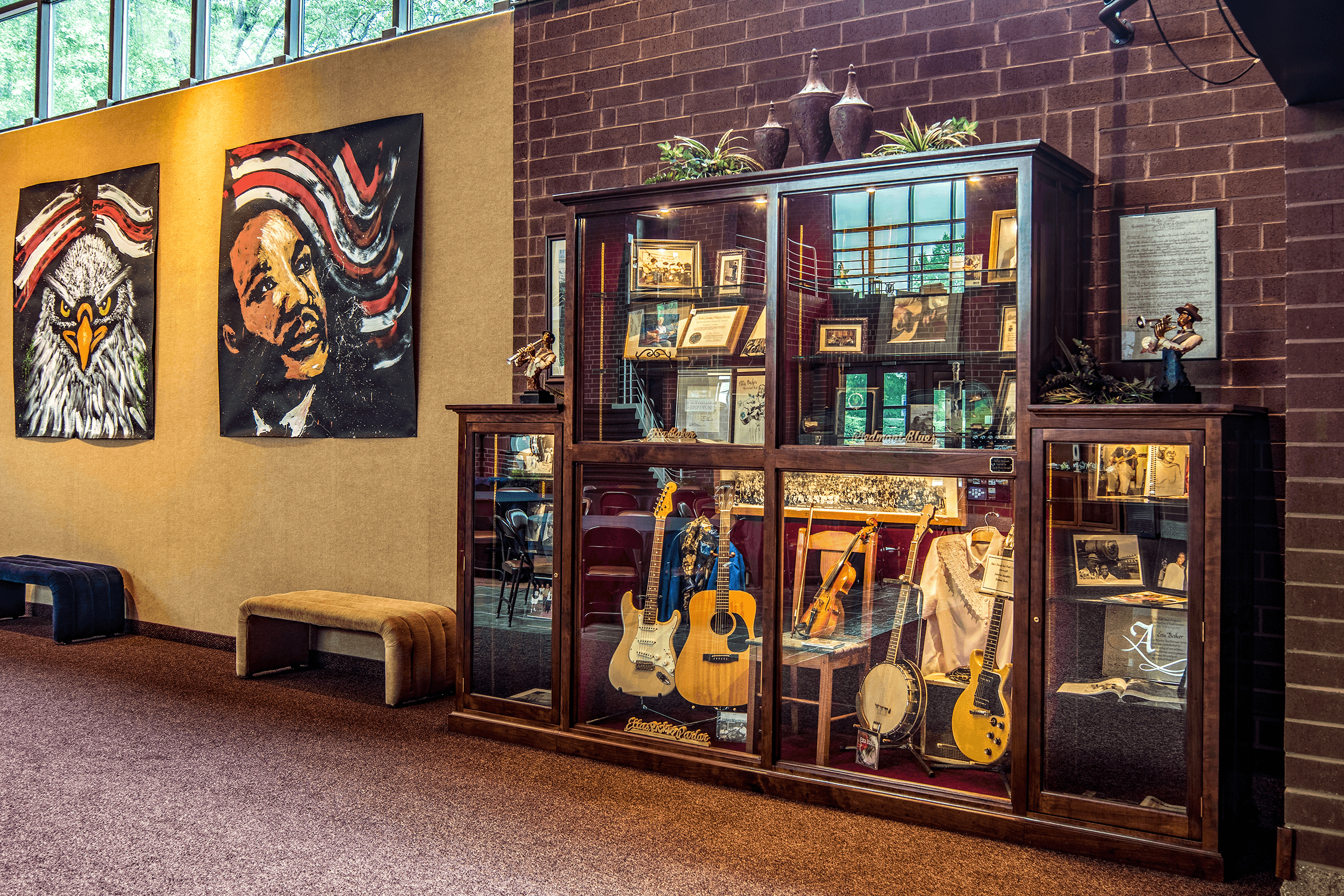Etta Baker with her husband Lee raised nine children, many of which continue the family's musical tradition to this day. Several of Etta's instruments and other memorabilia are displayed in a memorial case in the atrium of the  Municipal Auditorium .