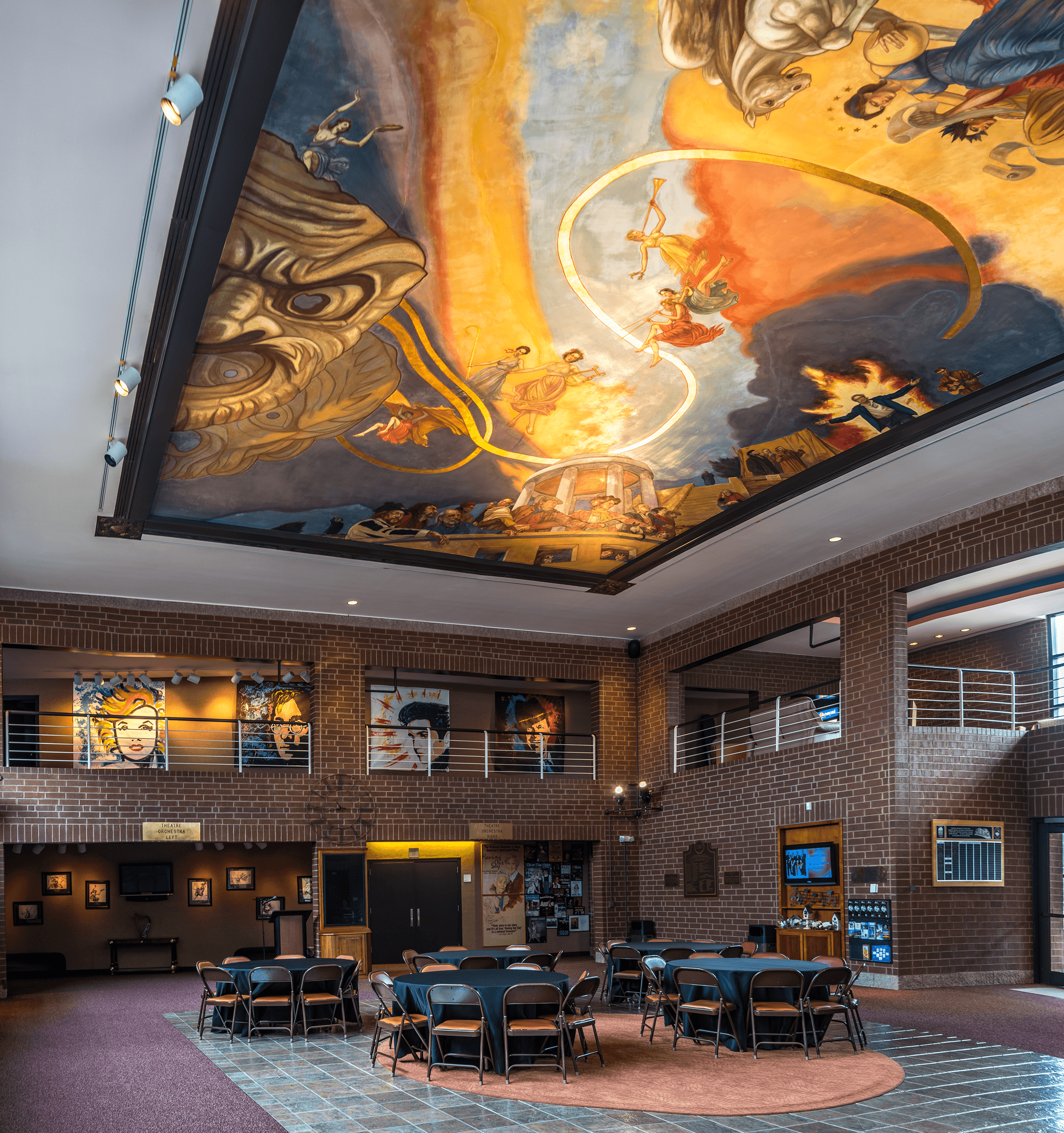 The atrium of the  Municipal Auditorium  also features an impressive ceiling fresco, titled  Sacred Dance & the Muses , by world-renowned fresco artist Ben Long. The fresco is approximately 24 feet wide, and 33 feet long (7 meters by 10 meters) with a 14-inch (36 centimeters) rise from the sides to its center. It took Ben Long and his team of three master artists and six apprentices three months to complete.