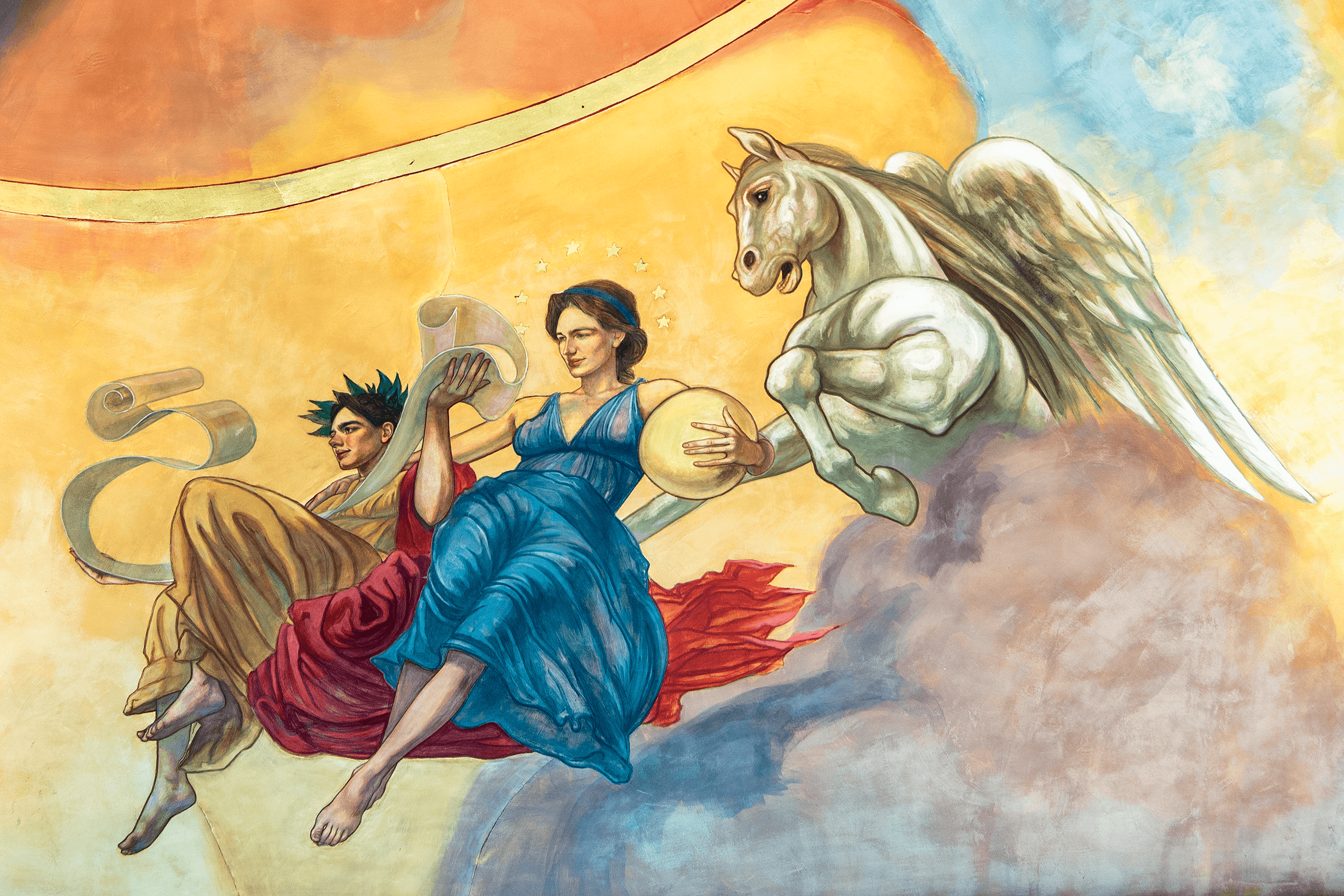 This group features  Urania , the Goddess of Astronomy, at the center surrounded by stars and holding a planet. She is accompanied by  Clio , the Goddess of History, holding a long roll of papyrus. From the clouds appears  Pegasus , a muscular winged divine stallion.