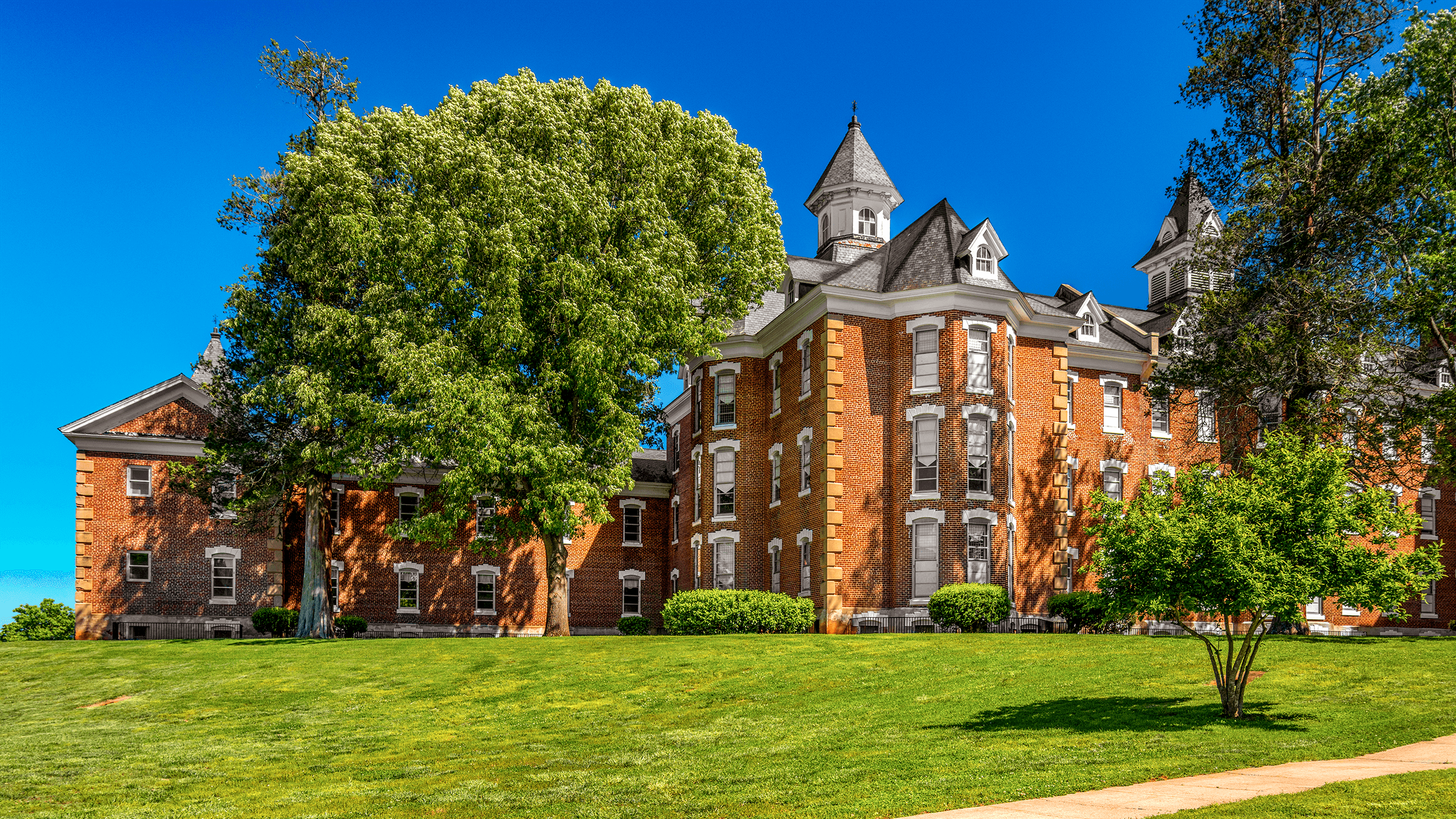The success of the hospital led the General Assembly to appropriate the required funds to finally finish the north wing, increasing the capacity for an additional 190 patients. In 1890, the  Western North Carolina Insane Asylum  officially changed its name to  State Hospital at Morganton , a designation it kept until 1959 when it became  Broughton Hospital , named for WWII Governor of North Carolina Joseph Melville Broughton (1888-1949).