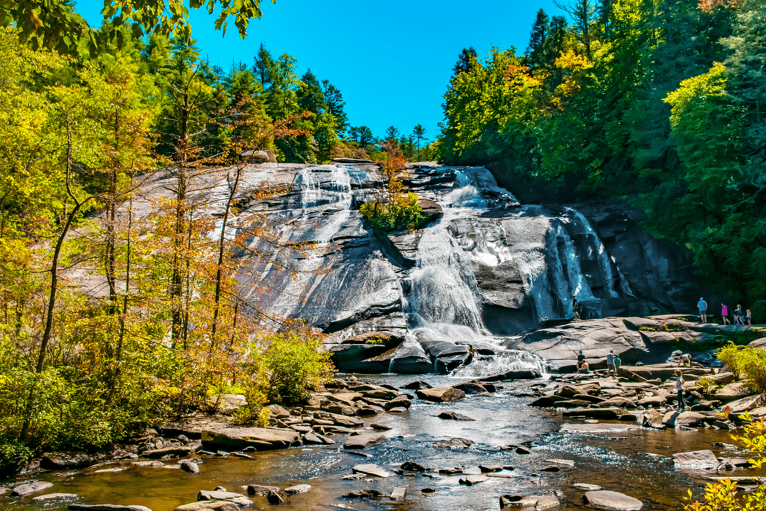 A view from the bottom of  High Falls . On a warm day, it's the perfect place to sit back on one of the large boulders at the base and listen to the roar of the water. In a series of short falls and long cascades, the water drops around 100 feet.