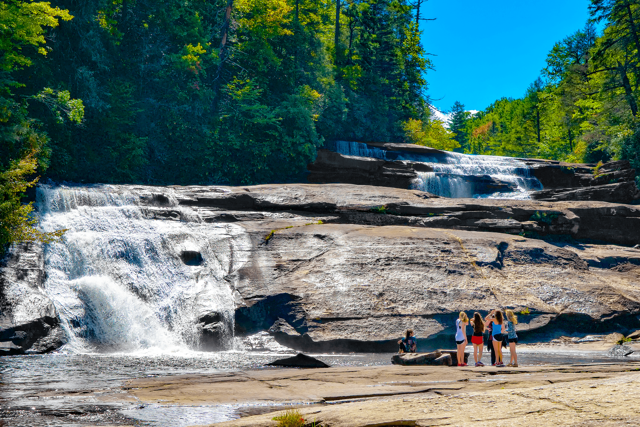 Triple Falls  got its name from the three-tiered series of gentle falls and cascades amounting to a 100 feet drop.