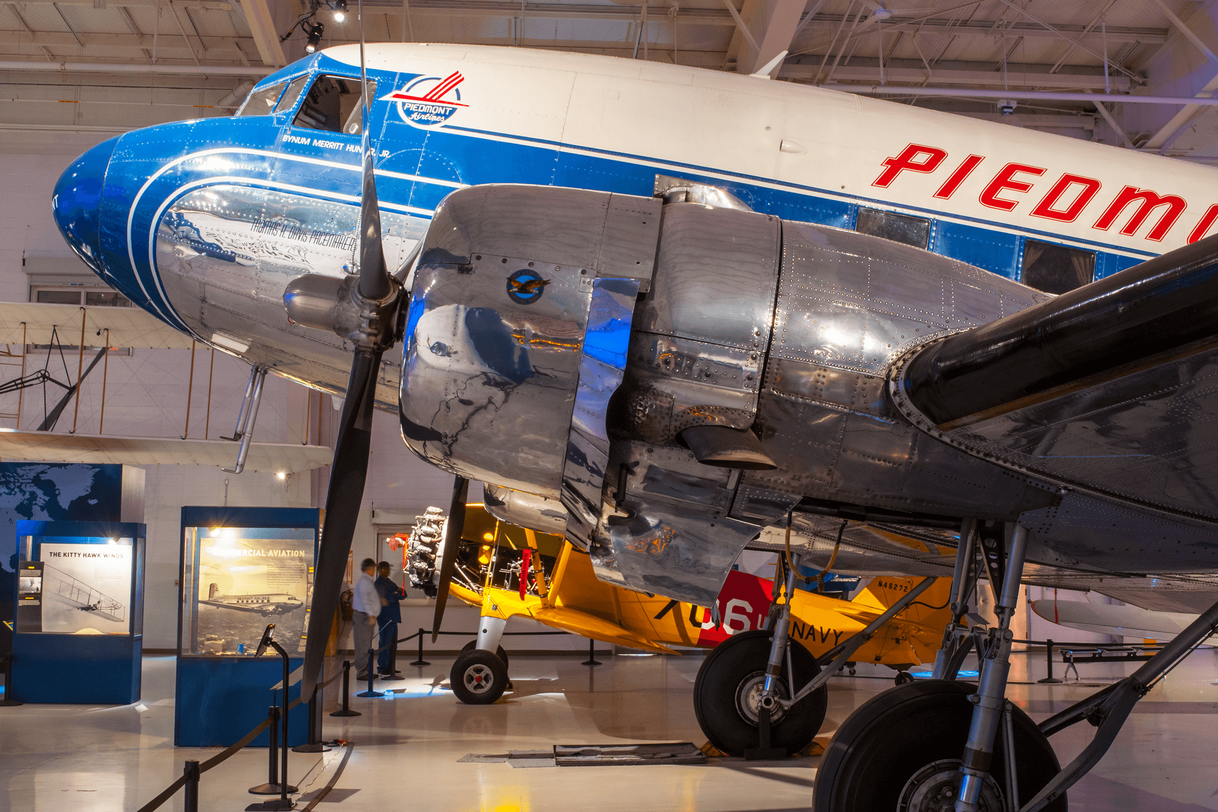 After WWII, many DC-3 were available at little cost. Also, many pilots, who during WWII flew the C-47, the military version of the DC-3, were looking for jobs. Therefore, in the late 1940s and early 1950s, many new airlines were formed using the DC-3 as their primary aircraft. The DC-3 on display was initially built as a C-47 cargo plane in 1942. Piedmont Airlines acquired the aircraft in 1986 and restored it to an original airline configuration.