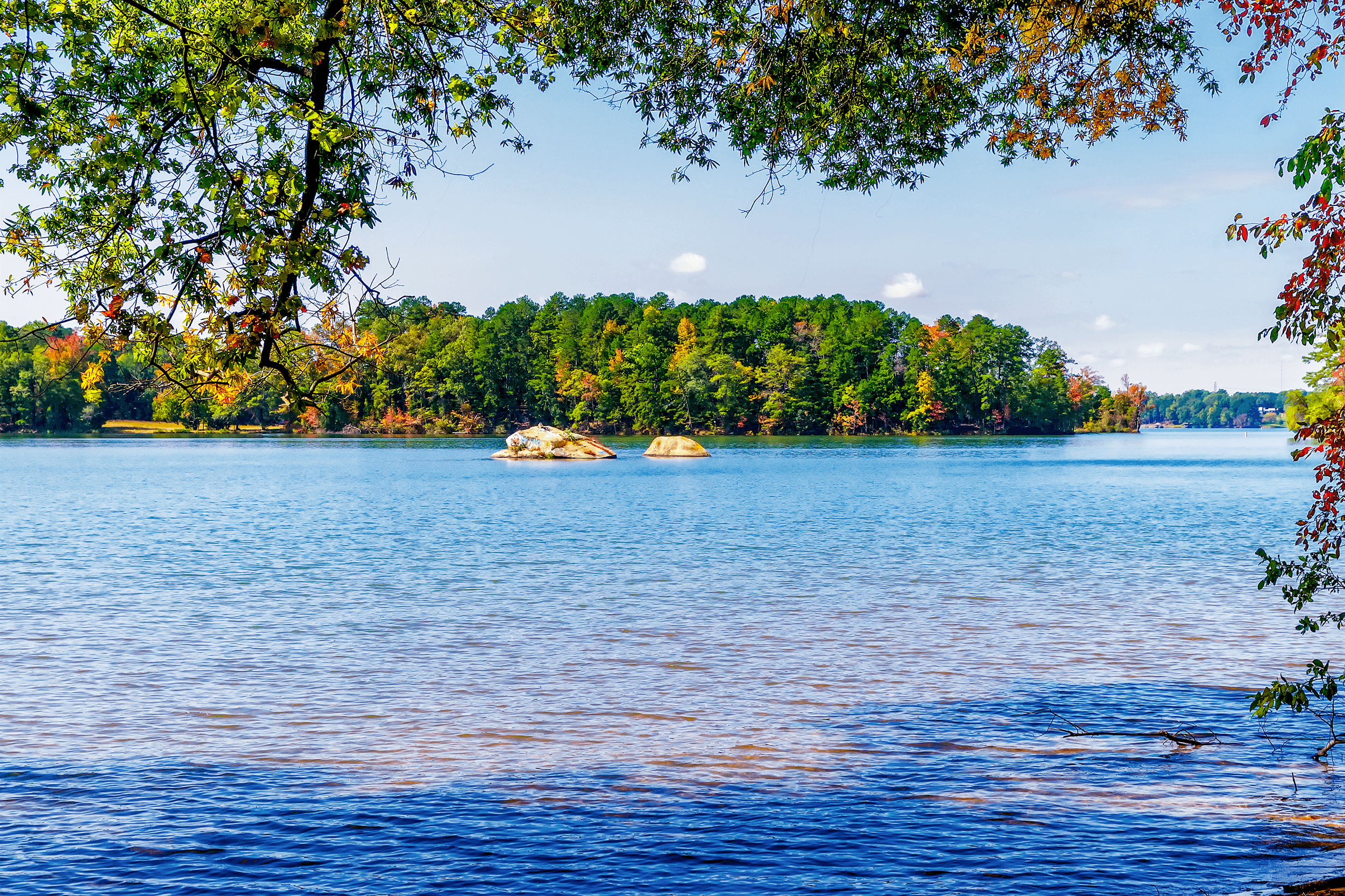 Two rock outcrops in  Mountain Island Lake  can be seen along the  Cattail Trail .
