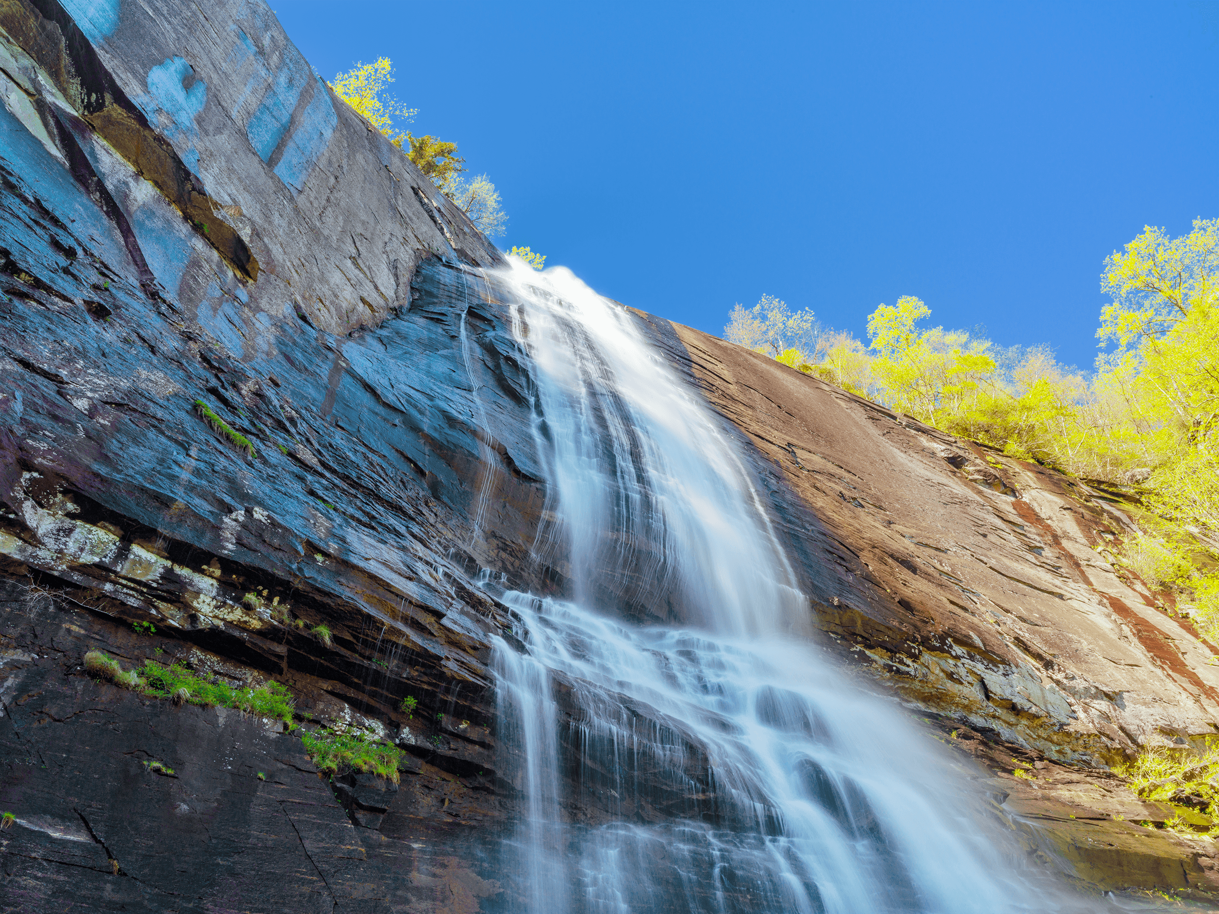 As the viewing platform is almost below  Hickory Nut Falls , it offers a dramatic perspective looking up the falls, while feeling the refreshing cooling mist from the water on a hot day.