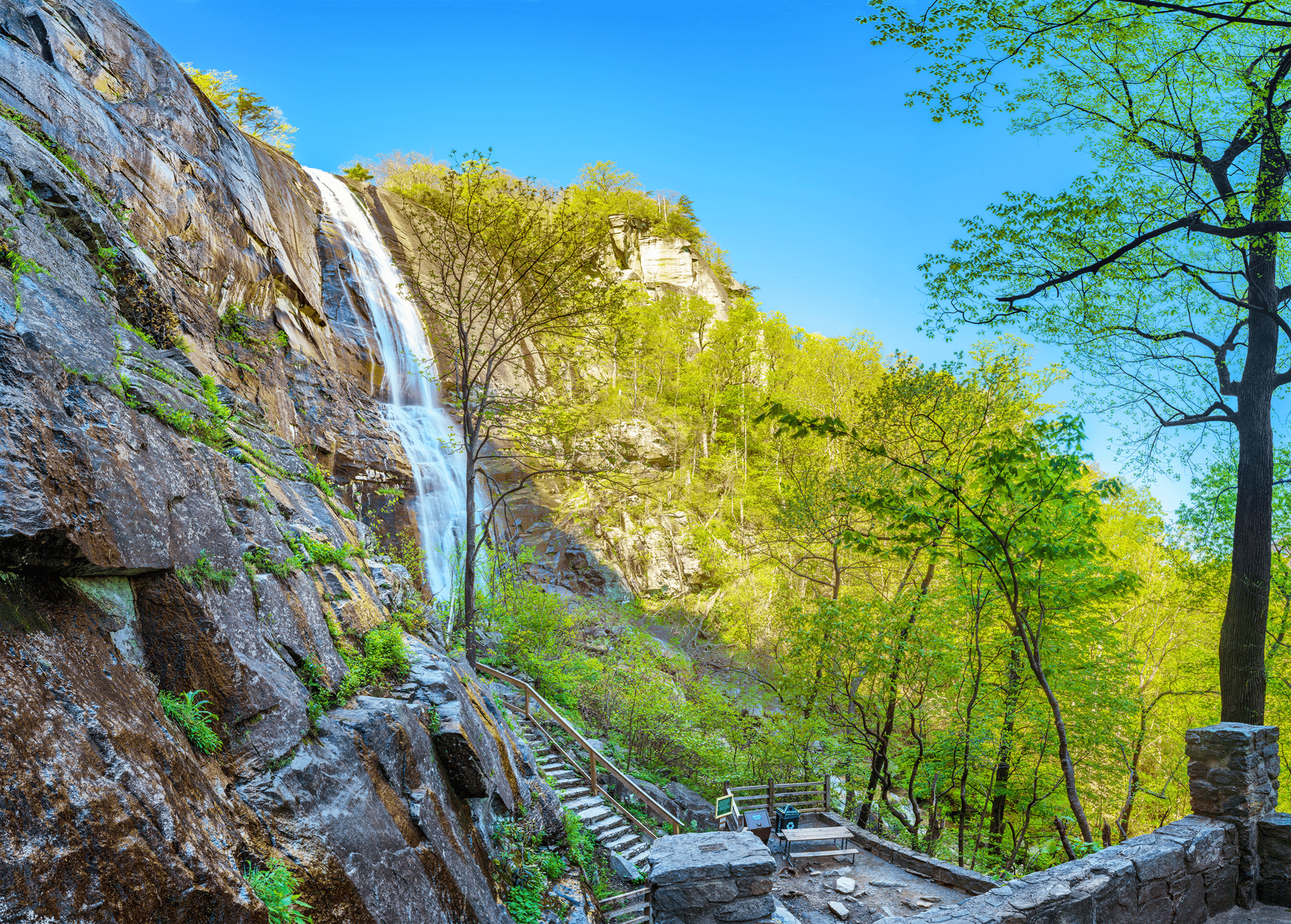 Especially after a couple of days of rain, the thundering  Hickory Nut Falls  is an impressive sight even from a distance. To get closer to the 404-foot (123 meters) waterfall, follow the path with the stone steps.