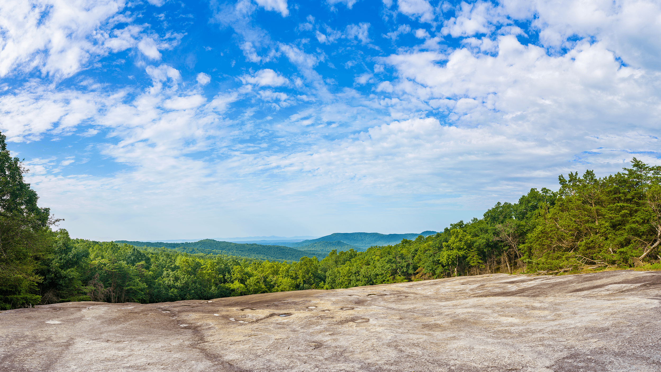 The  Upper Parking Lot  connects with the  Stone Mountain Loop Trail . After a 20-minute ascent, we reached the first of several lookouts.
