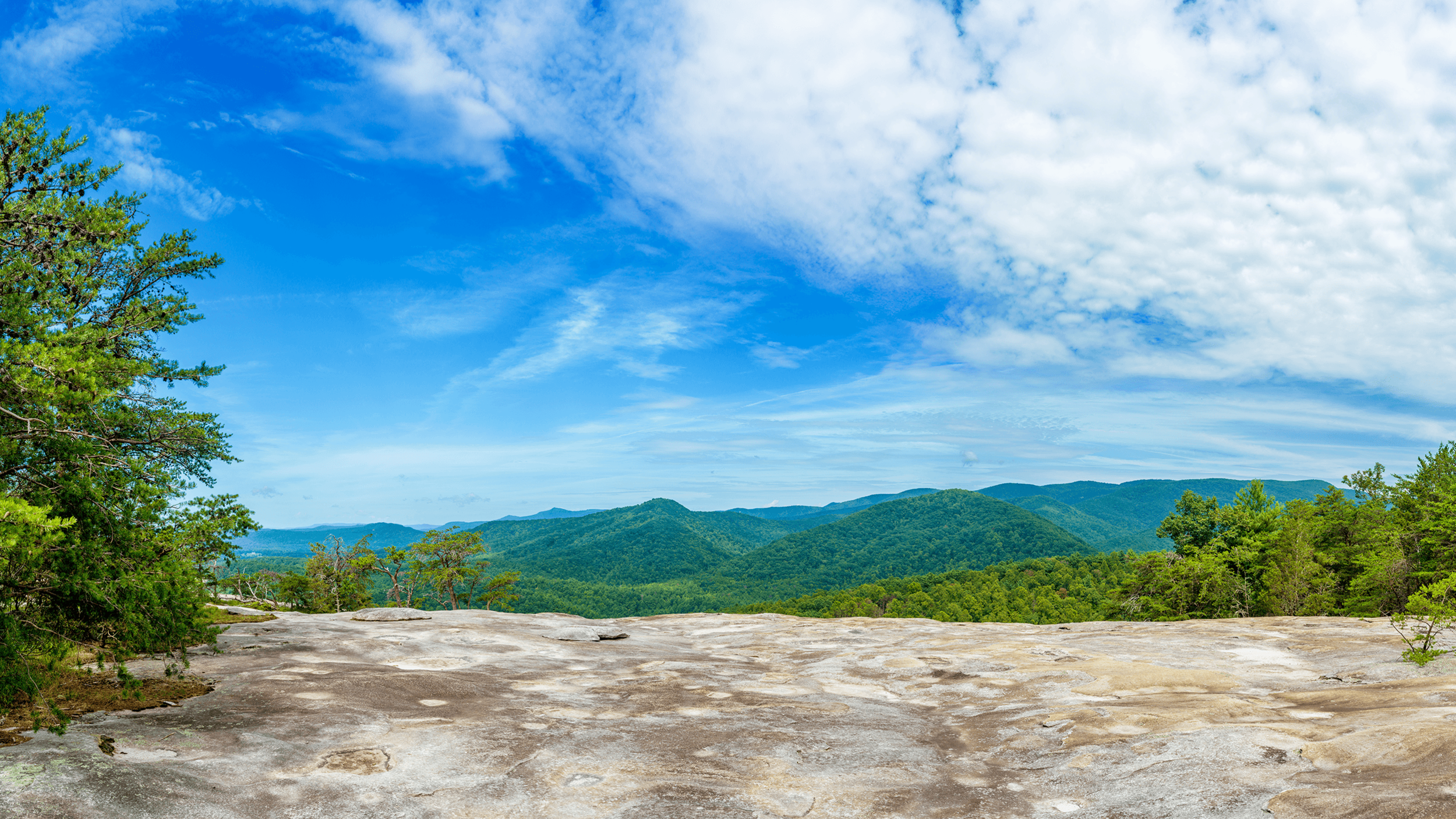 The west-facing  Wolf Rock  offers stunning views of the Blue Ridge Mountains.