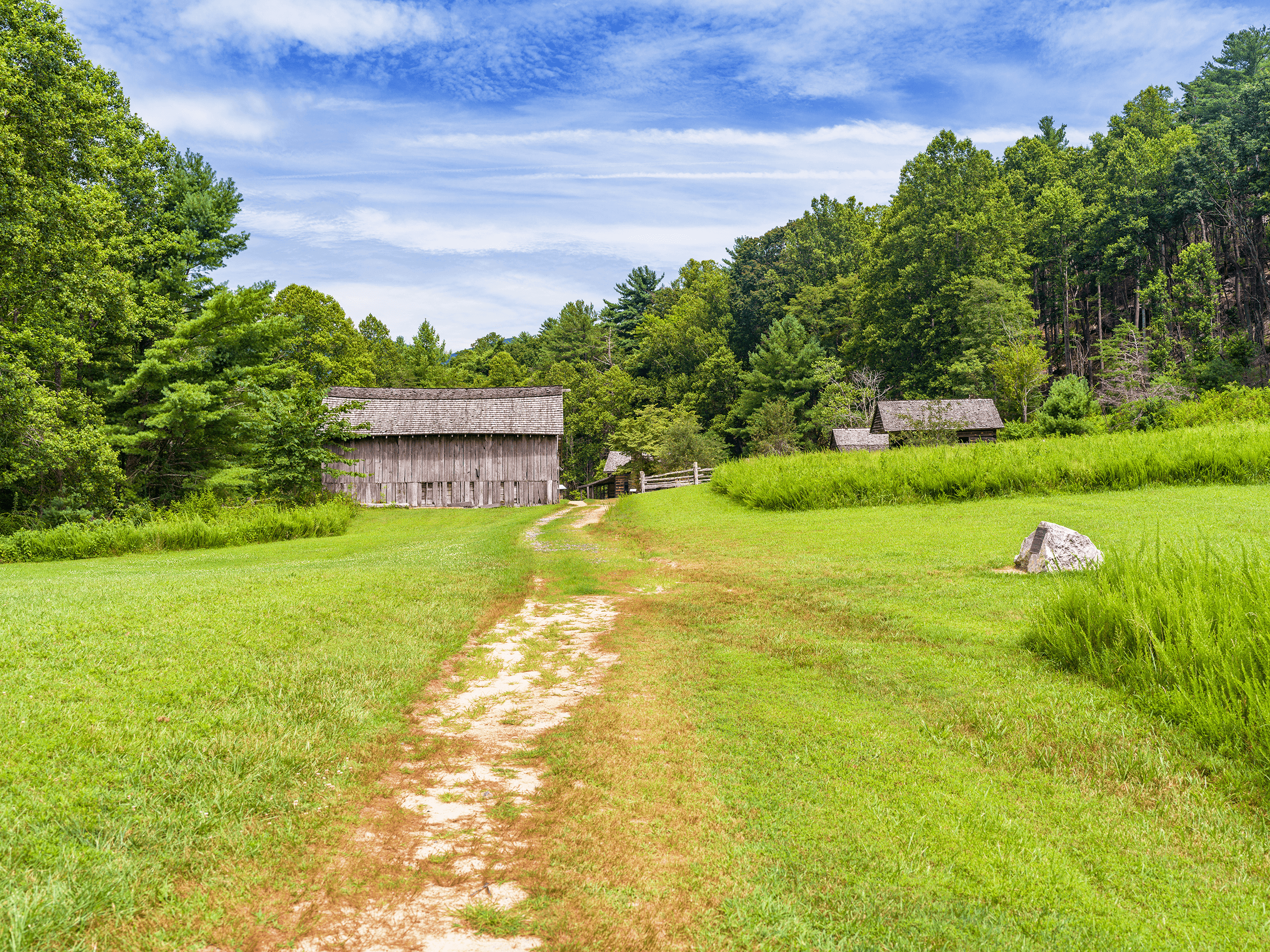 The park also preserves the area's rich history. The restored  Hutchison Homestead  features several buildings from the mid-1800s, such as a log cabin, barn, blacksmith shop, and meat house.